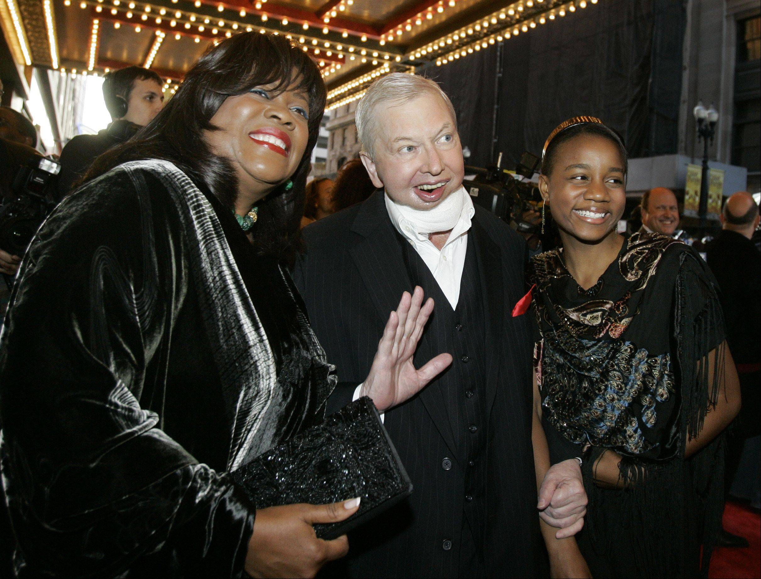 Film critic Roger Ebert, center, his wife Chaz, left, and their granddaughter Raven Evans, right, arrive for the Chicago premier of the the Broadway hit The Color Purple, Thursday, May 3, 2007.