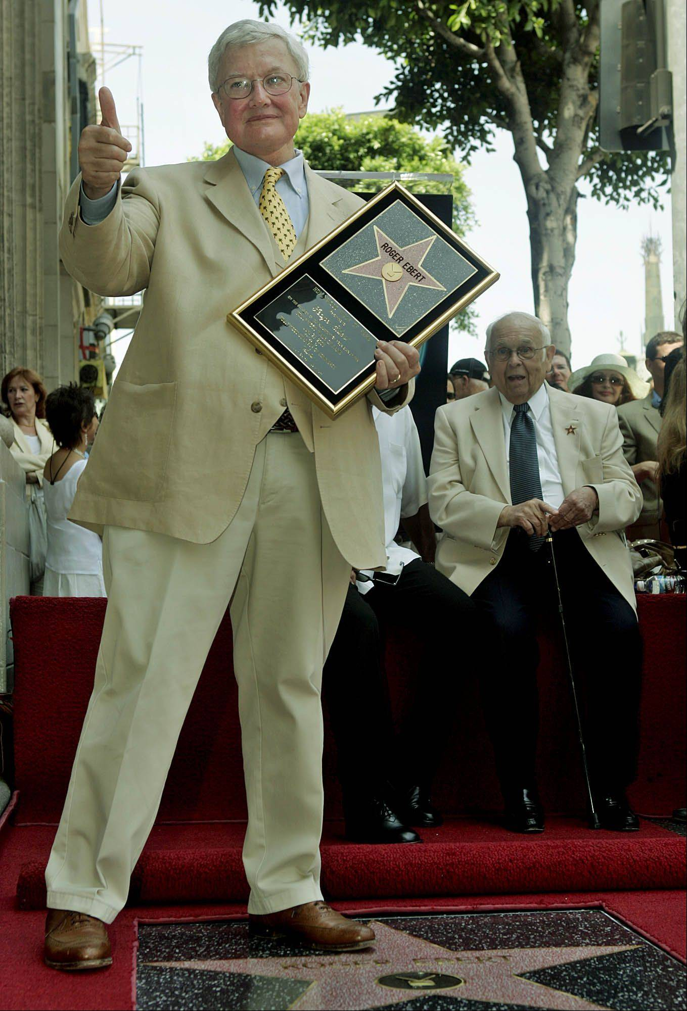 Film critic Roger Ebert poses for photographers Thursday, June 23, 2005, in the Hollywood section of Los Angeles. Ebert was honored Thursday with a star on the Hollywood Walk of Fame.