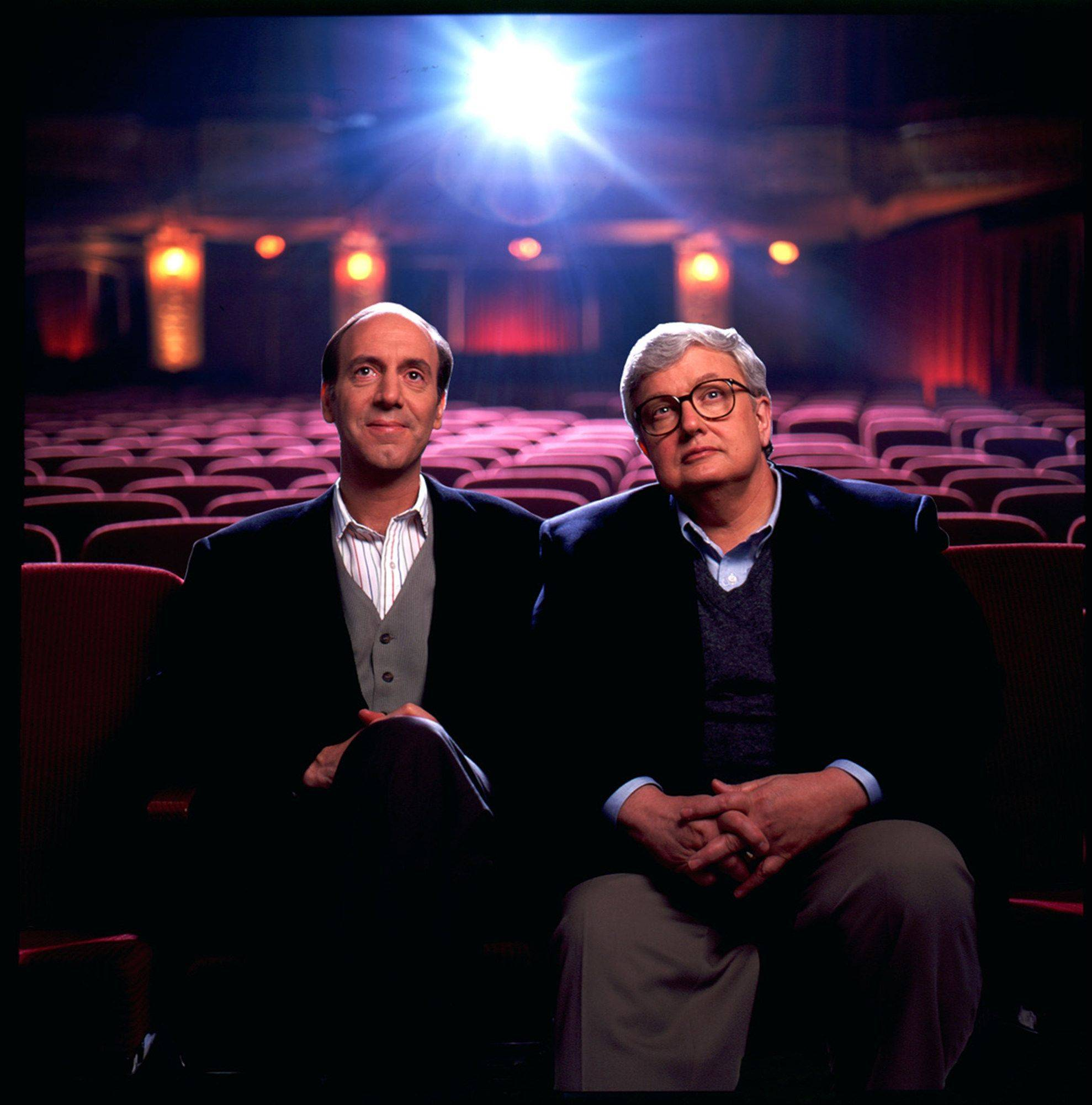 Roger Ebert, right, became a celebrity in his own right hosting a national TV show with fellow critic Gene Siskel. Their thumbs-up appraisal was actually trademarked.