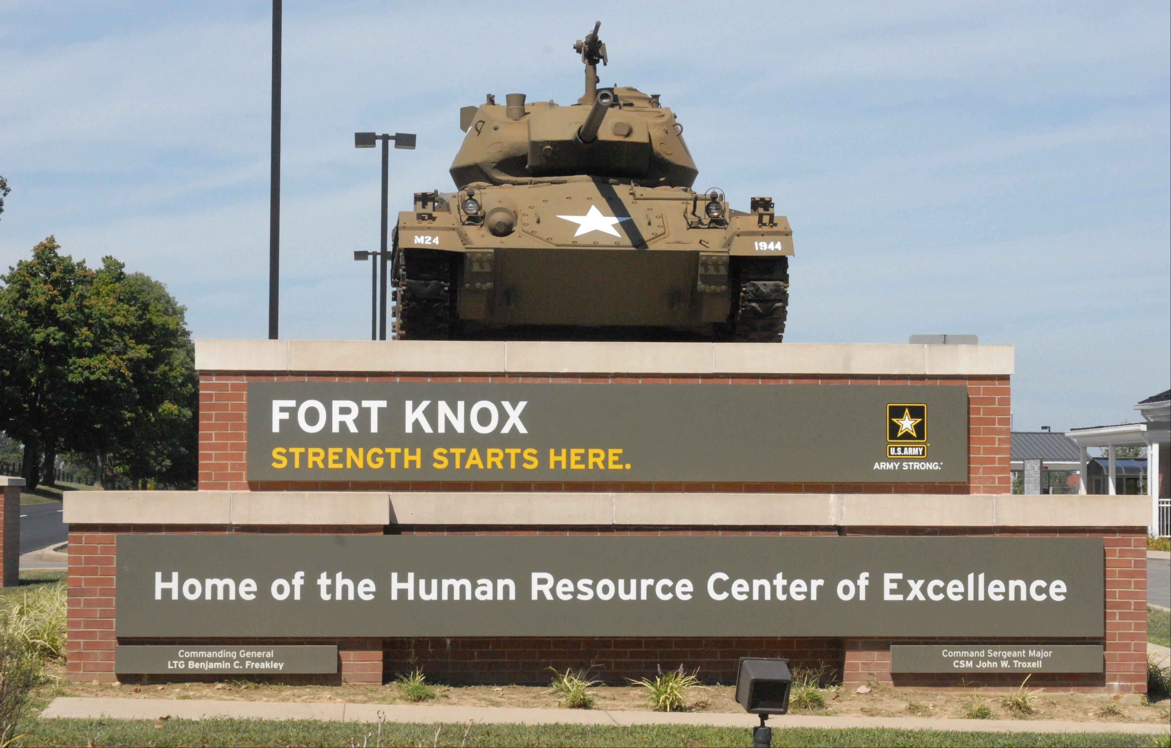 An Army civilian employee was shot and killed in a parking lot at Kentucky's Fort Knox on Wednesday, and investigators were seeking to question a man in connection with the shooting, authorities said.