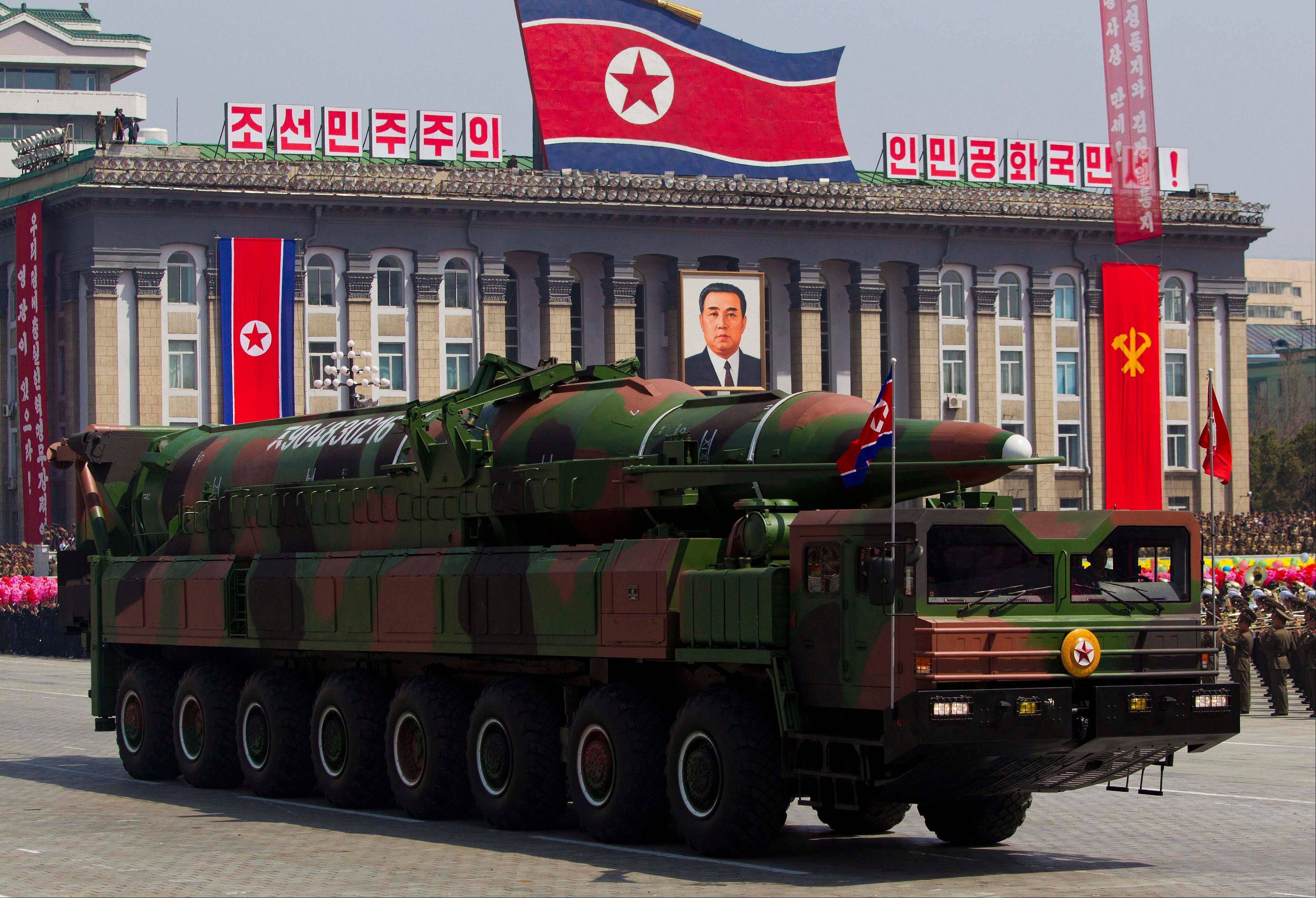 "A North Korean vehicle carrying a missile passes by during a mass military parade in 2012. North Korea has moved a missile with ""considerable range"" to its east coast, South Korean Defense Minister Kim Kwan-jin said, but he added that there are no signs that Pyongyang is preparing for a full-scale conflict."