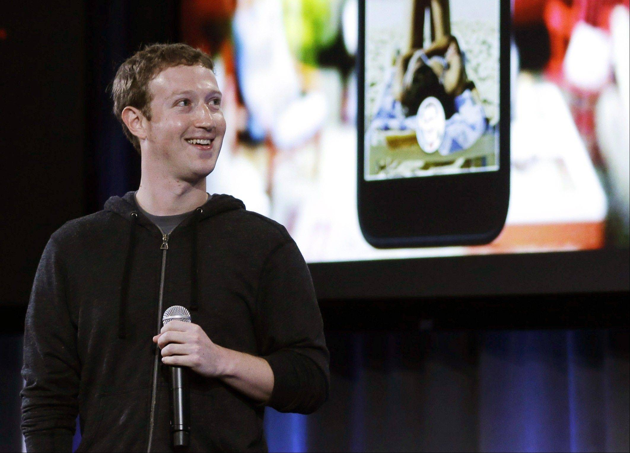 Facebook CEO Mark Zuckerberg speaks at the company's headquarters in Menlo Park, Calif., Thursday, April 4, 2013. Zuckerberg says the company is not building a phone or an operating system. Rather, Facebook is introducing a new experience for Android phones. The idea behind the new Home service is to bring content right to you, rather than require people to check apps on the device.