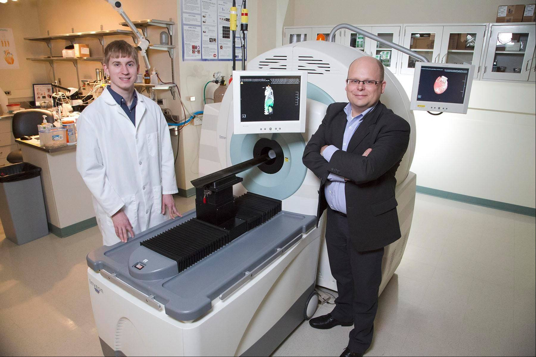 University of Illinois senior Matt Schuelke assists senior research scientist Wawrzyniec Dobrucki with cutting-edge imaging research aimed at benefiting diabetic patients. The Hoffman Estates native, who five years ago suffered a serious brain injury while skiing, has been accepted into multiple MD/Ph.D. programs.