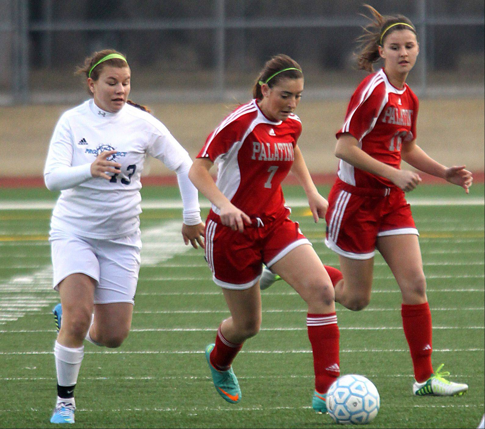 Prospect's Rosie Pettenuzzo, left, pursues Palatine's Michelle Raymond, center, as Palatine's Erin Mayer, right, follows the play during Thursday's game at George Gattas Memorial Stadium.