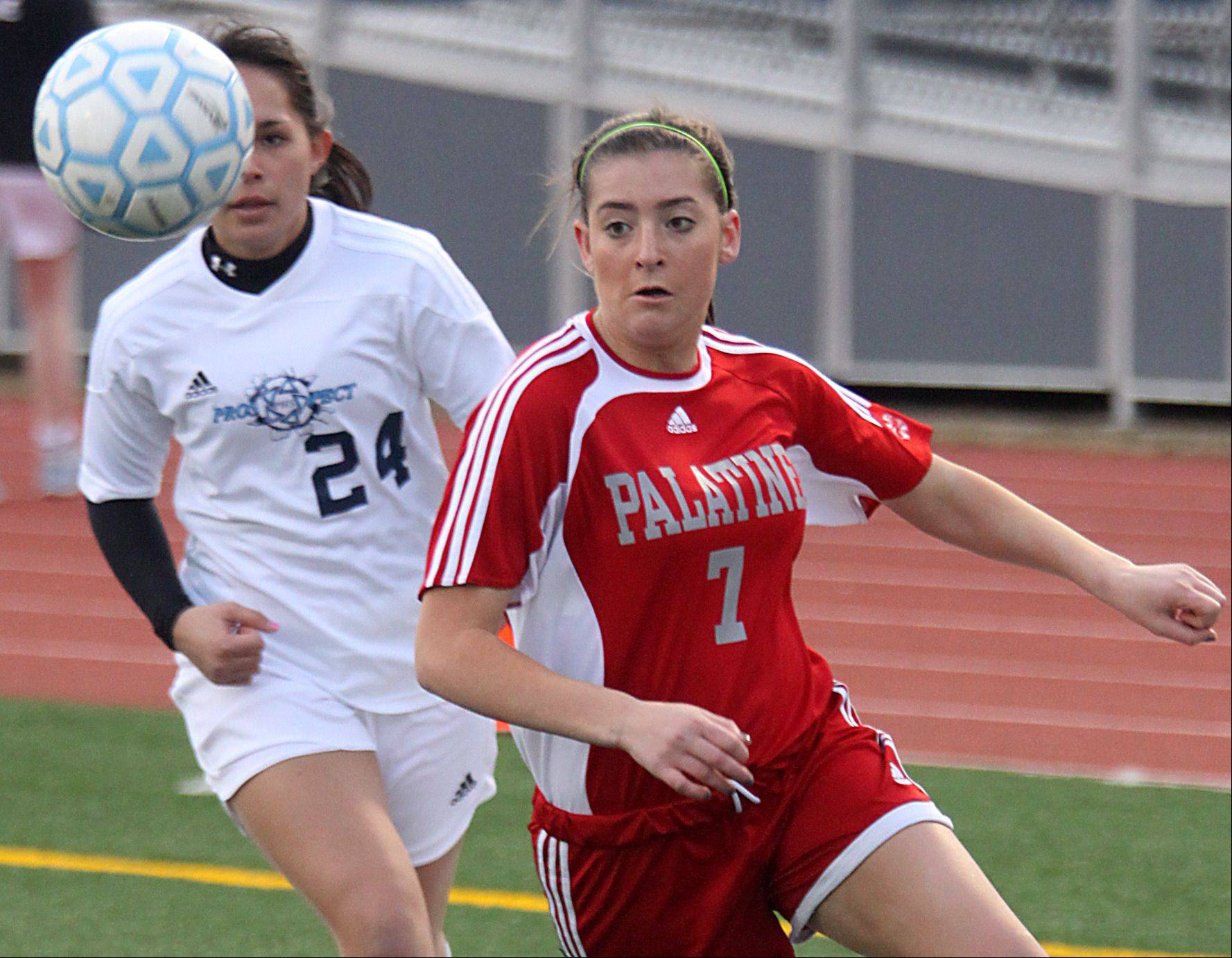 Prospect's Elena Cukurs, left, and Palatine's Michelle Raymond, right, pursue the ball Thursday at George Gattas Memorial Stadium in Mount Prospect.