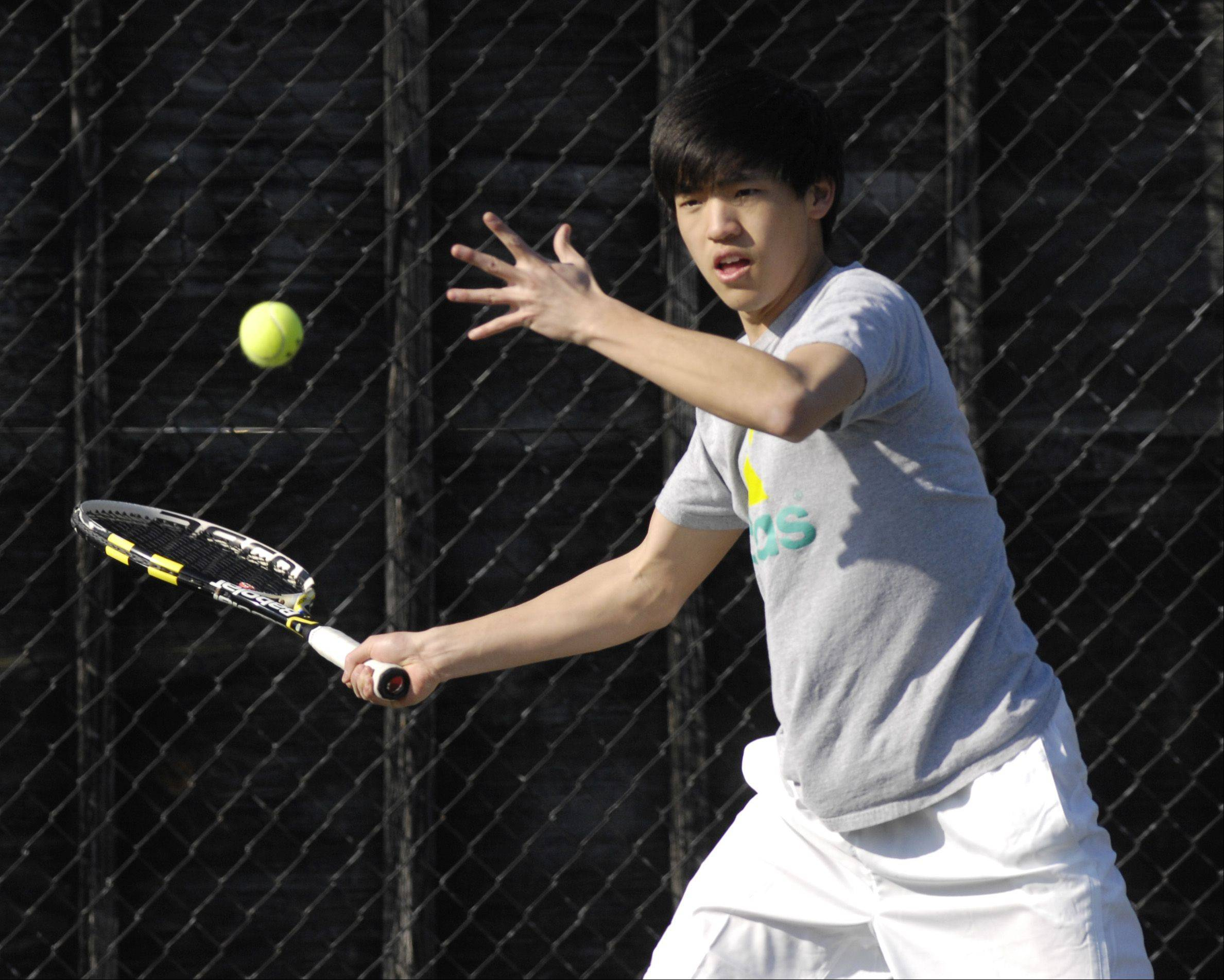 Benny Li of Naperville North plays against Steven Hanna of Glenbard West during a boys varsity tennis match at West, Thursday.