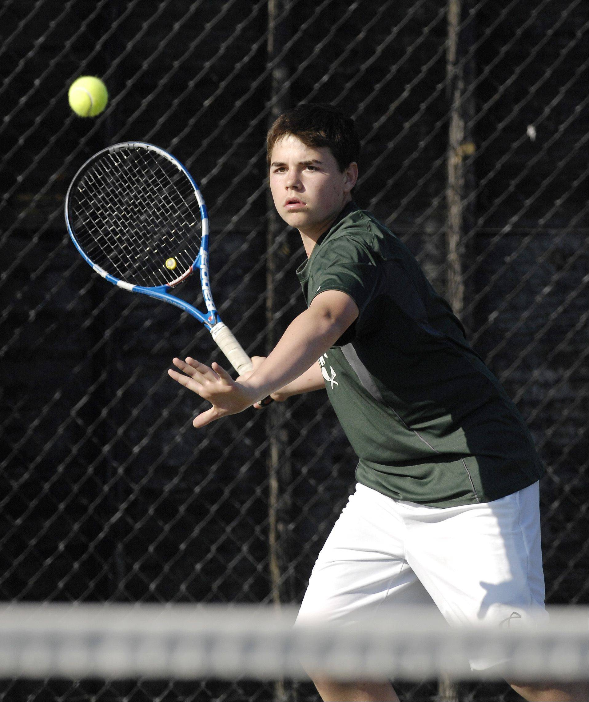 Nate Dell of Glenbard West plays against Terrance Chen of Naperville North during a boys varsity tennis match at West, Thursday.