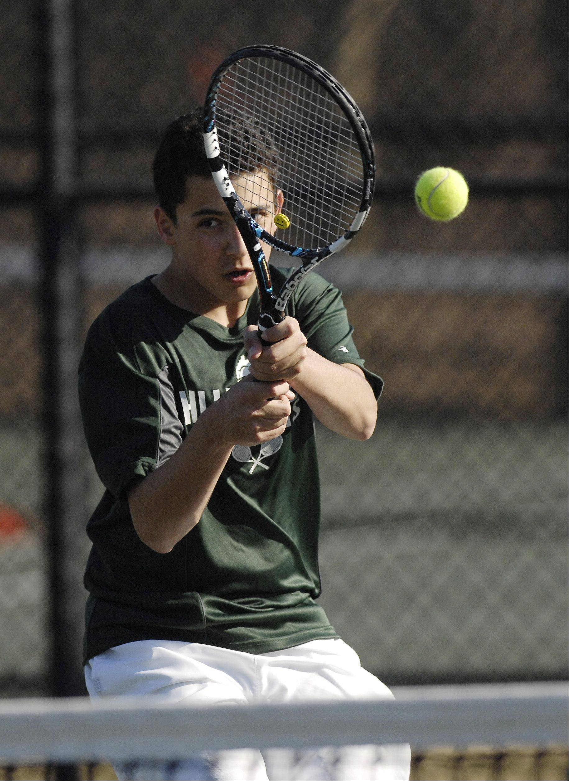 Steven Hanna of Glenbard West plays against Benny Li of Naperville North during a boys varsity tennis match at West, Thursday.