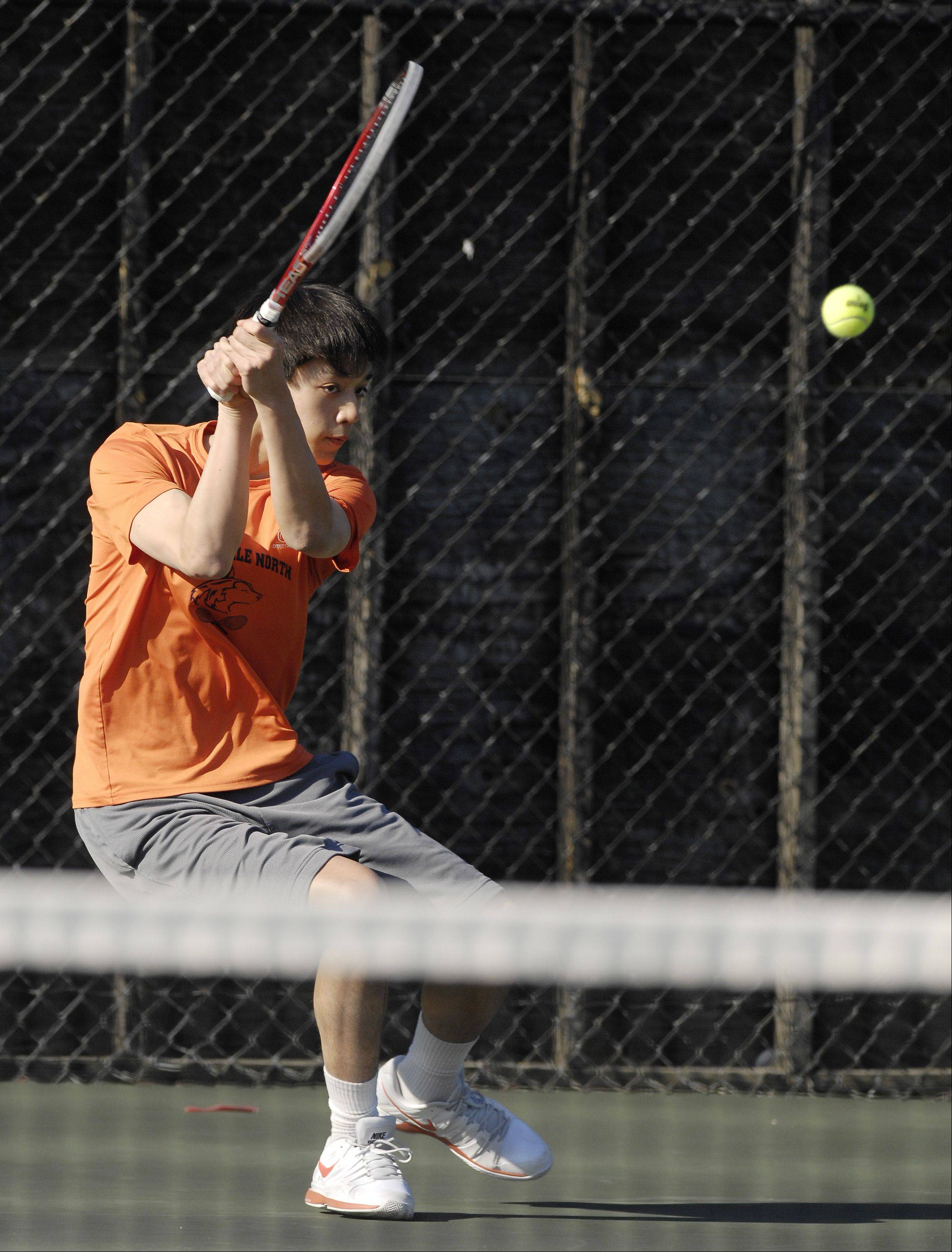 Terrance Chen of Naperville North plays against Nate Dell of Glenbard West during a boys varsity tennis match at West, Thursday.
