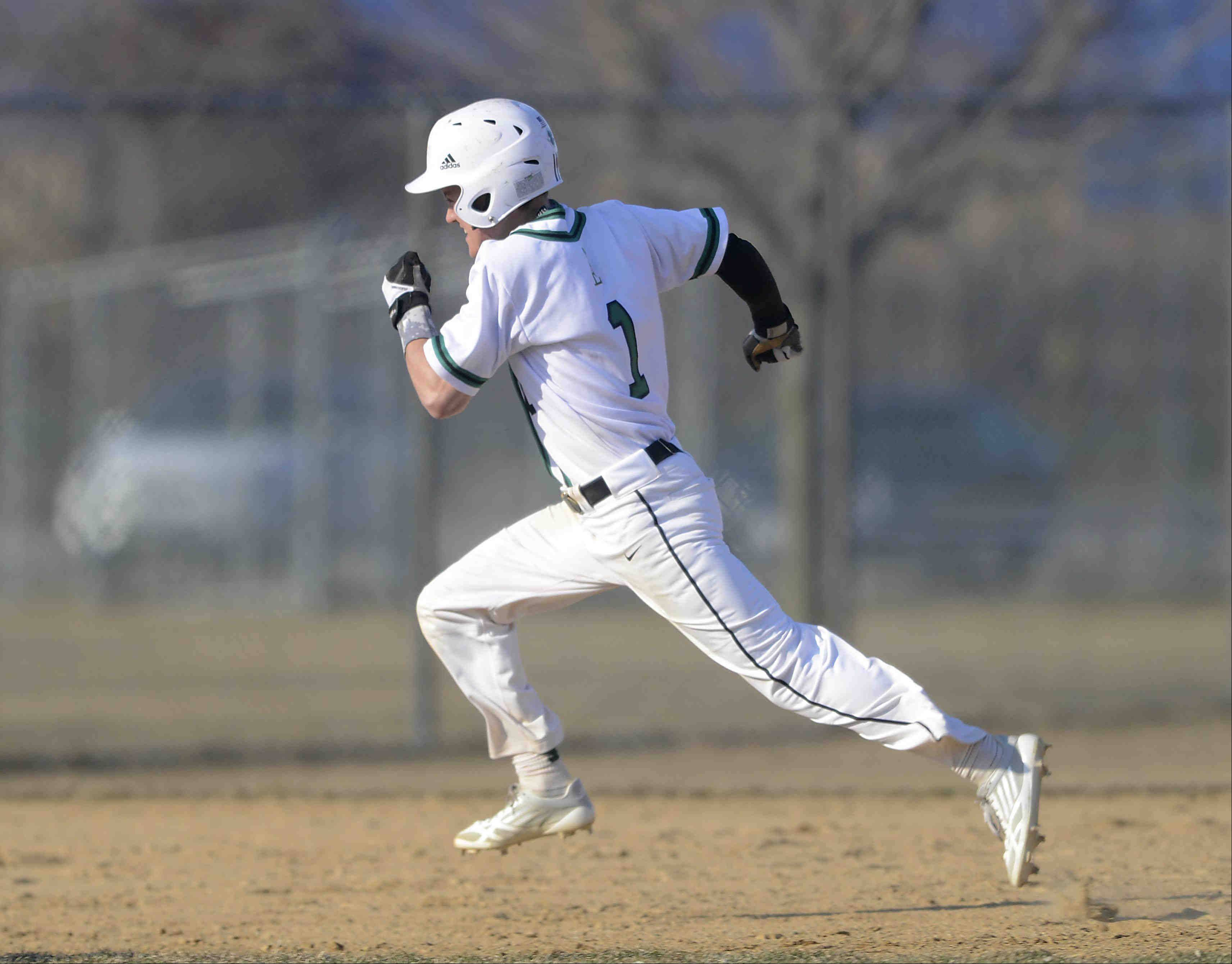 St. Edward's Michael Castoro sprints toward third base on his way to a 2-run triple in the third inning against Aurora Christian Thursday in Elgin.