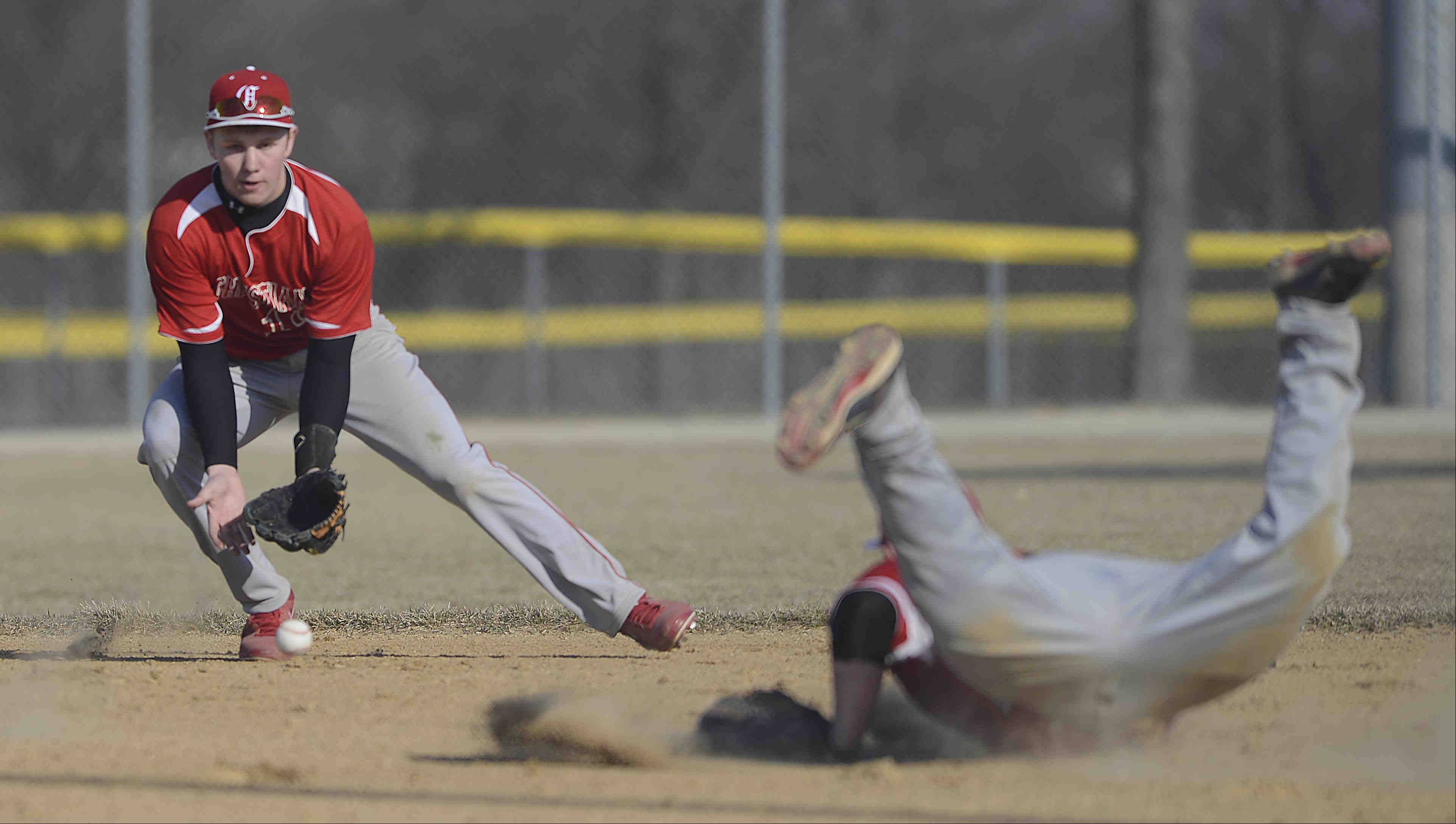 Aurora Christian first baseman Tristin Withrow falls face first into the dust as second baseman R.D. Lutze makes the play on a ground ball hit by St. Edward's Antonio Domel Thursday in Elgin. Lutze threw out Domel to end the first inning as pitcher Chase Tomney covered first.