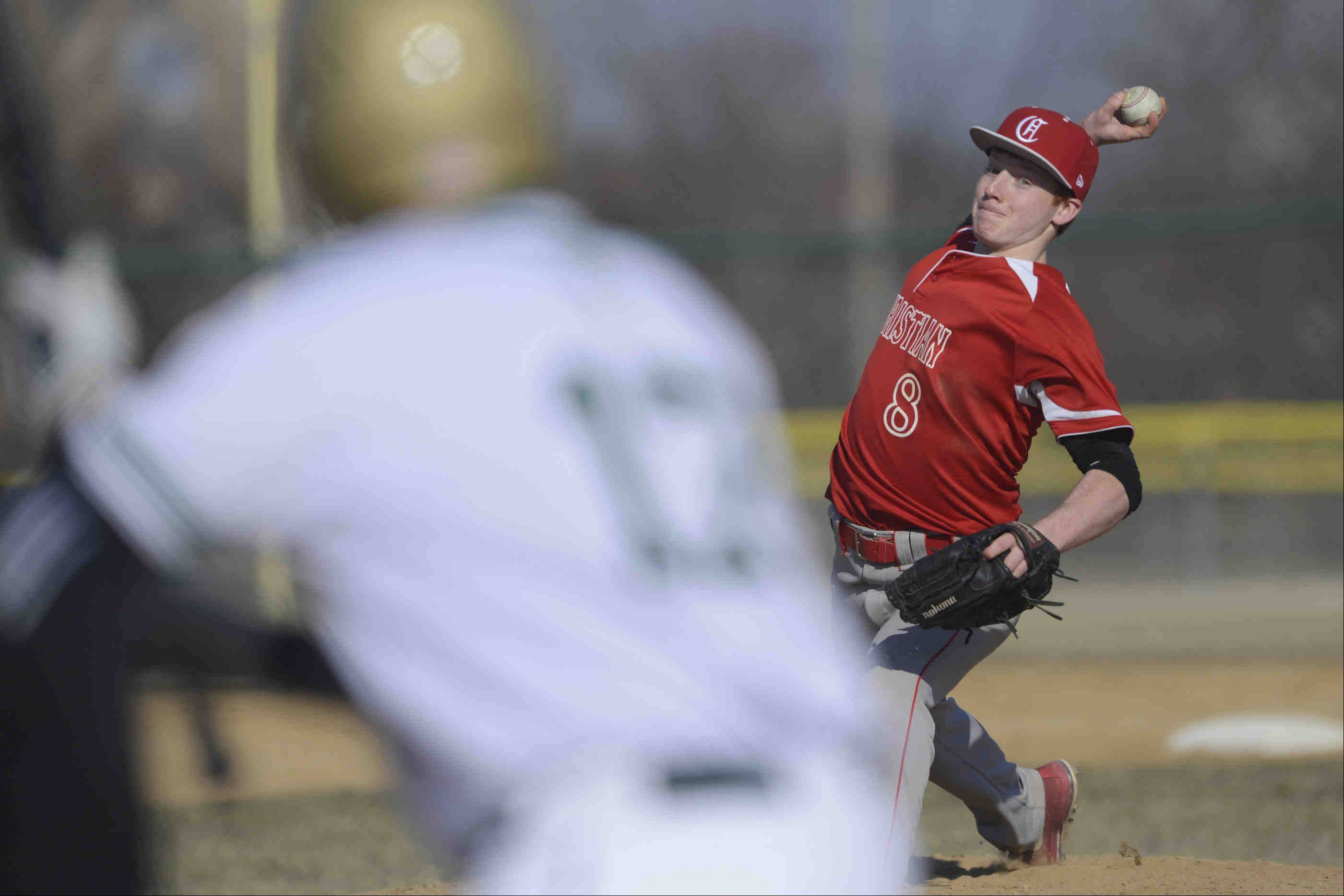 Aurora Christian starting pitcher Chase Tomney delivers against St. Edward's Jake Lafrenz Thursday in Elgin.