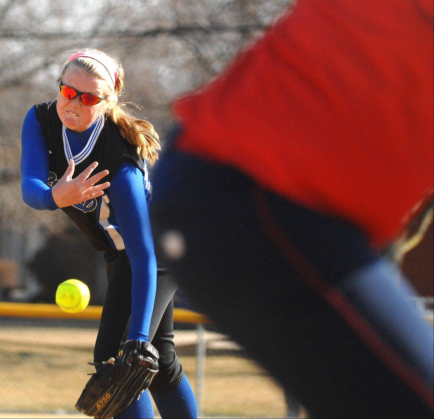 Rosary's Elayne Young delivers a pitch to a West Aurora batter during Thursday's game in Aurora.