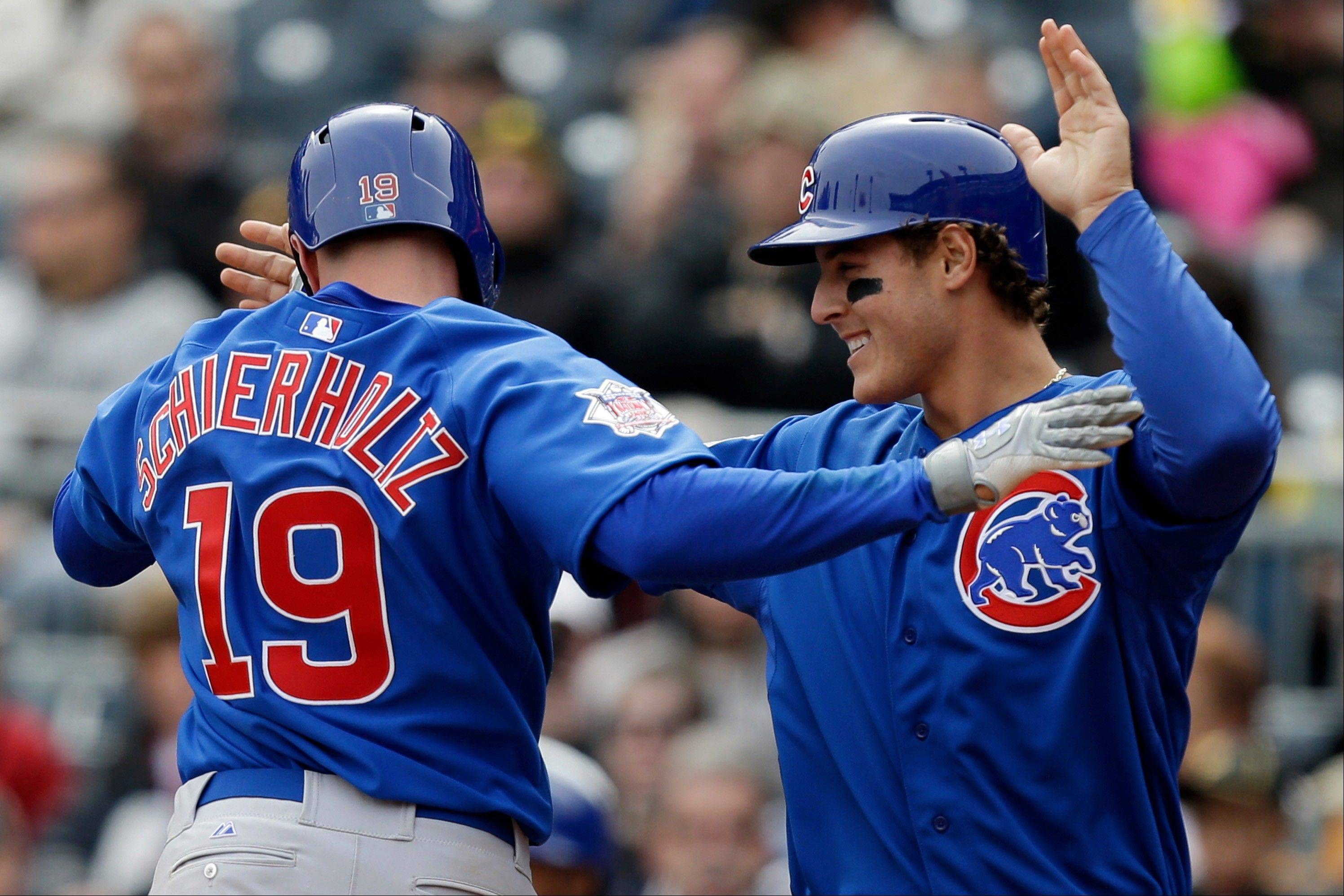 Cubs right fielder Nate Schierholtz (19) celebrates his two-run home run with teammate Anthony Rizzo during the ninth inning Thursday. The Cubs won 3-2.