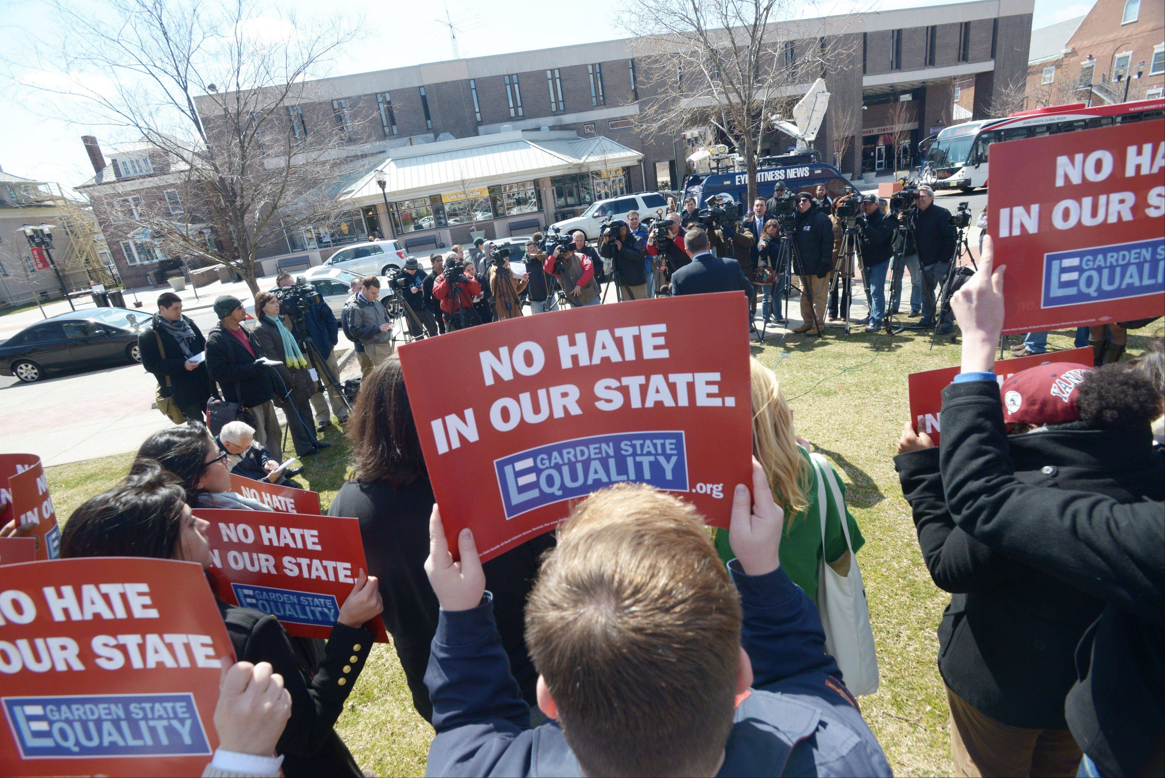 Troy Stevenson, Executive Director of Garden State Equality, organized a demo in New Brunswick, N.J., questioning why the firing of Mike Rice, the coach of Rutgers' men's basketball team, didn't happen sooner.
