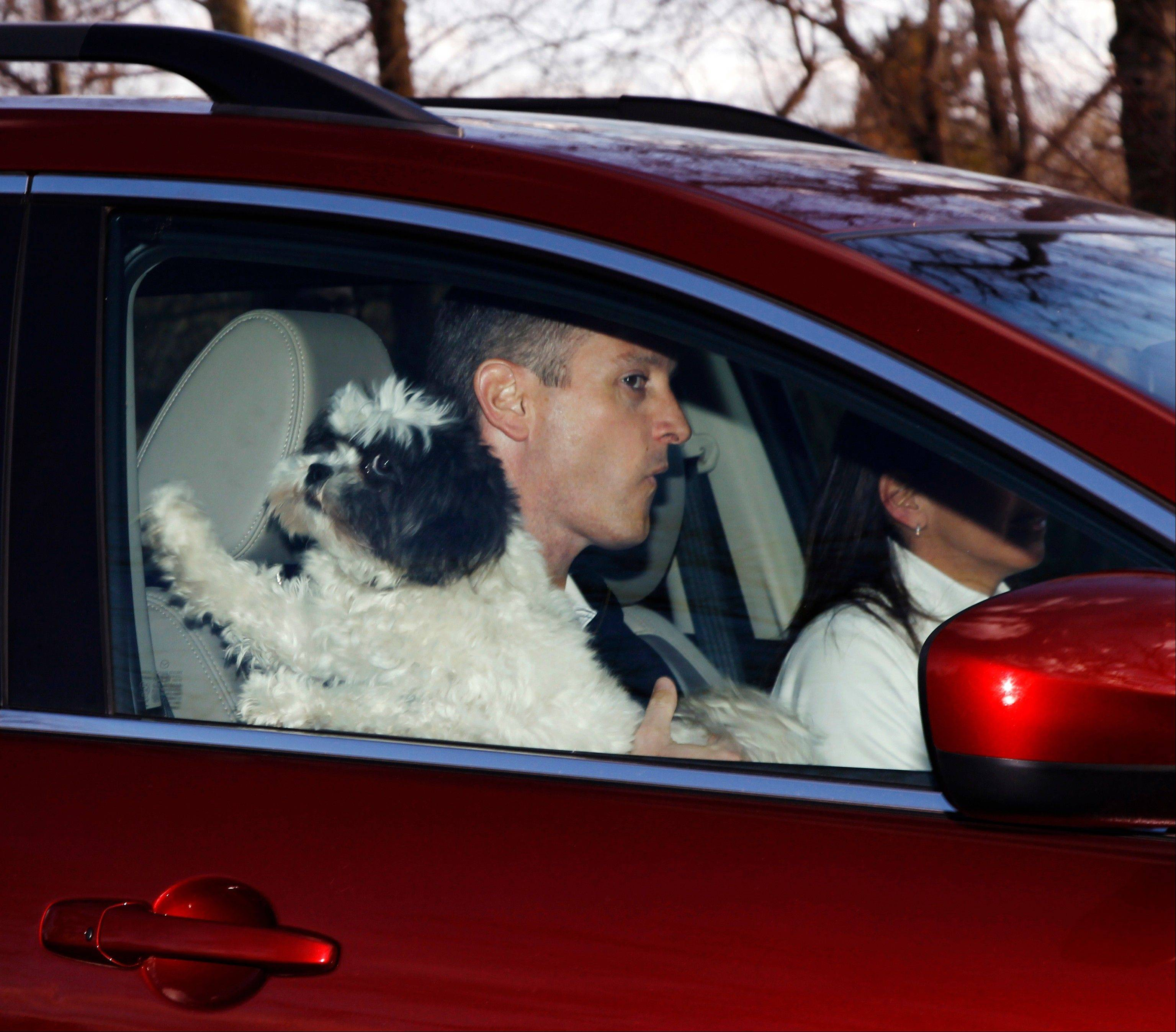 Former Rutgers head coach Mike Rice is driven from his home, Wednesday, April 3, 2013, in Little Silver, N.J. Rice is due a $100,000 bonus for lasting through the season.
