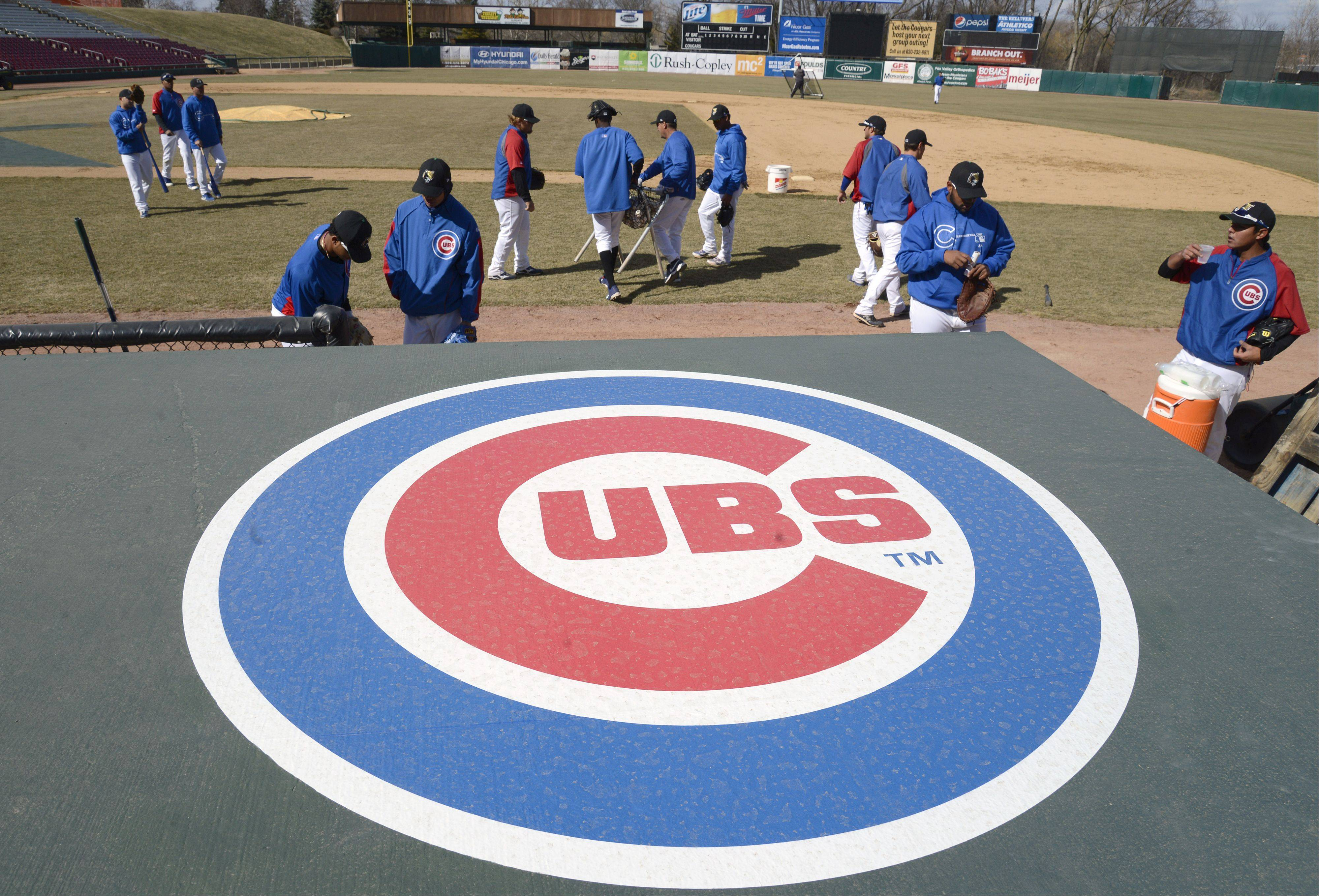 The Kane County Cougars, an affiliate of the Chicago Cubs, head out to the diamond at Fifth Third Ballpark in Geneva on Tuesday for some practice. The team also wore their Cubs jerseys for the workout. The two organizations have a two-year player development contract.