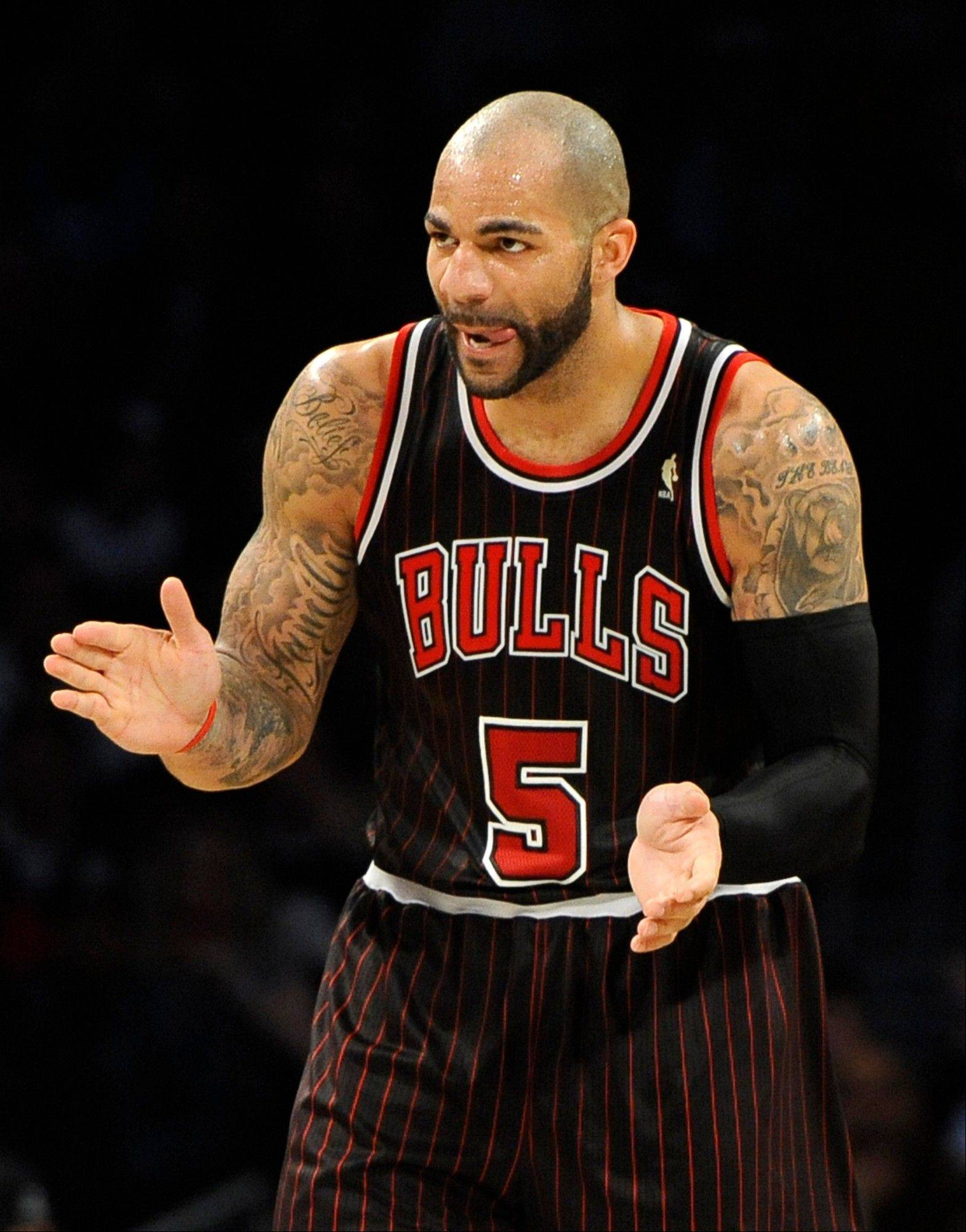 Carlos Boozer (5) celebrates as they come within one point of leading the Brooklyn Nets in the second half of an NBA basketball game on Thursday, April 4, 2013, at Barclays Center in New York. The Bulls won 92-90.