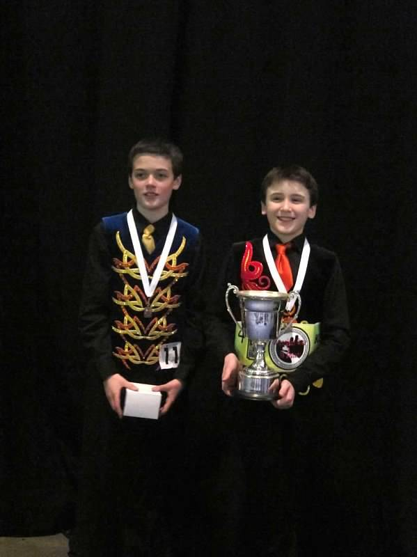 Ronan Donahue U13, Park Ridge and Kristjan Gundmundsson U12, Niles, display their World Medals, belt and trophies they won at the World Championship of Irish Dance competition recently in Boston.