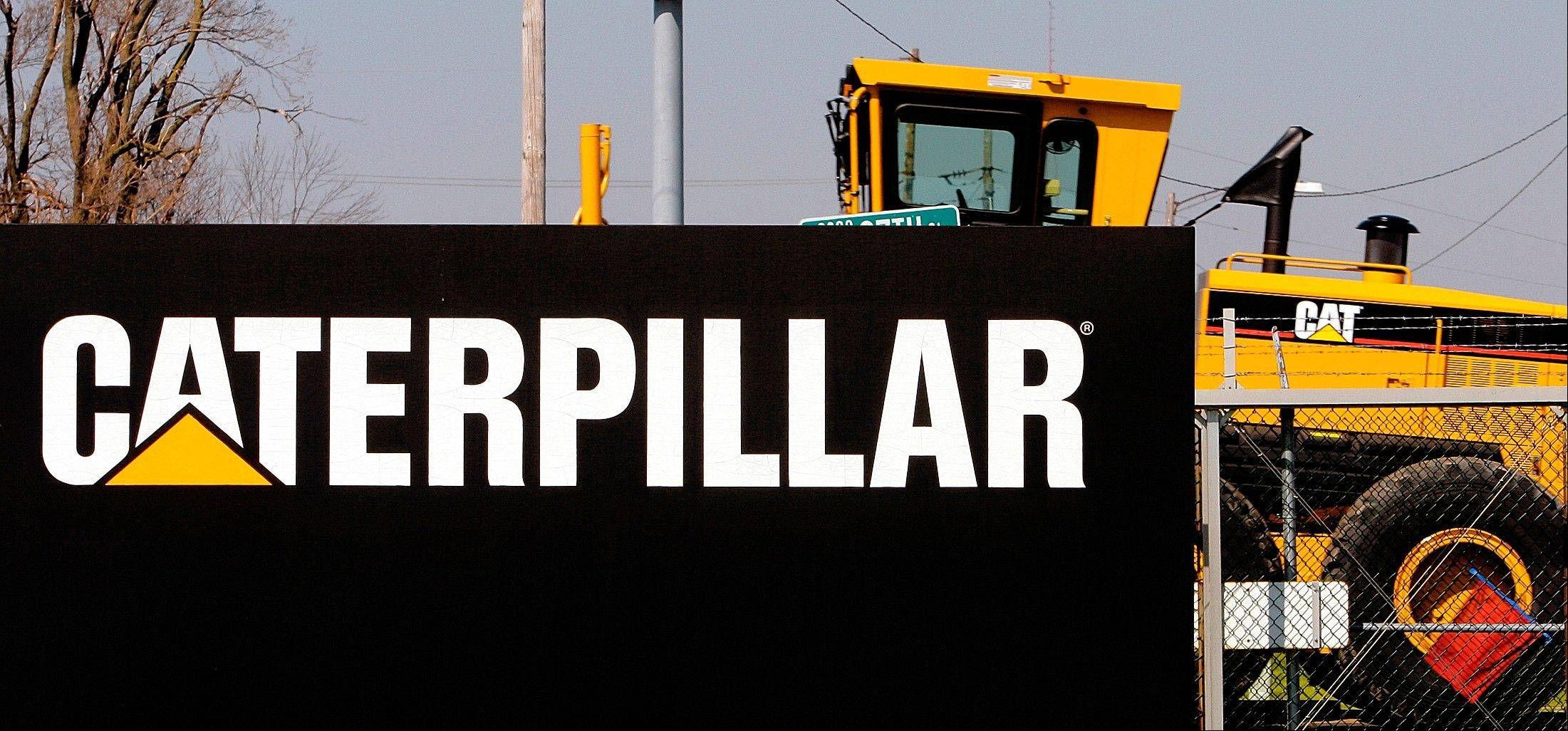 Associated Press/2007 A Caterpillar grader is trucked out of the plant in Decatur.