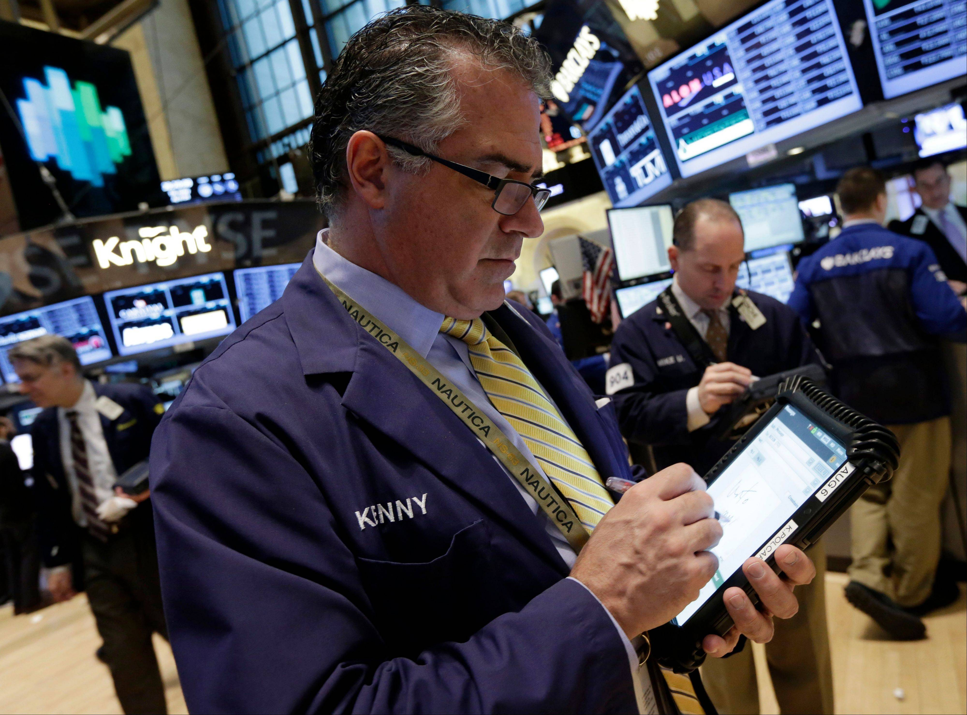 Trader Kenneth Polcari works Thursday on the floor of the New York Stock Exchange.