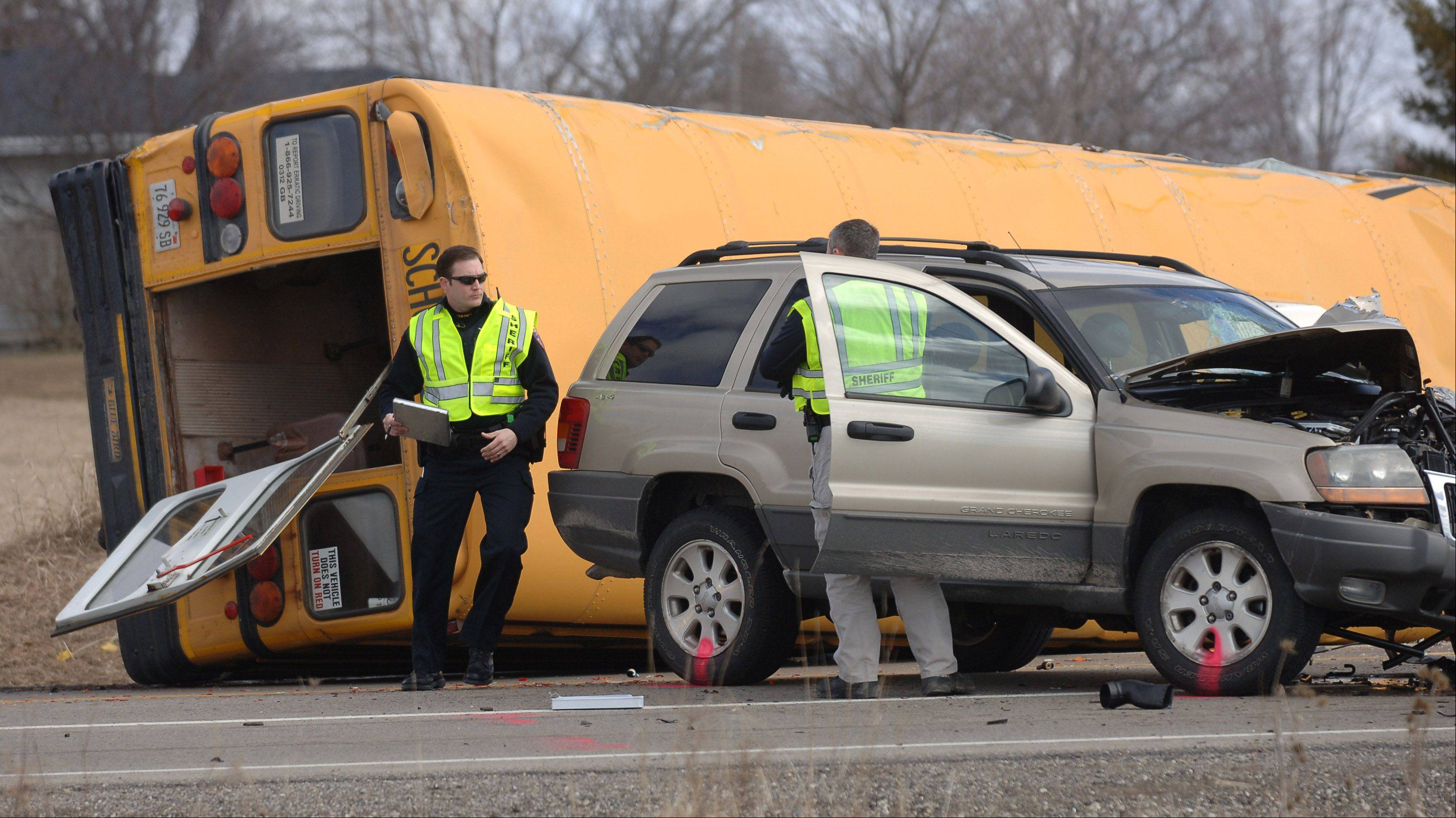 A school bus is on its side as police officials investigate the crash scene at Route 173 and N. Kilbourne Road near Wadsworth Friday morning. The bus carrying 35 students was heading to Newport Elementary School.