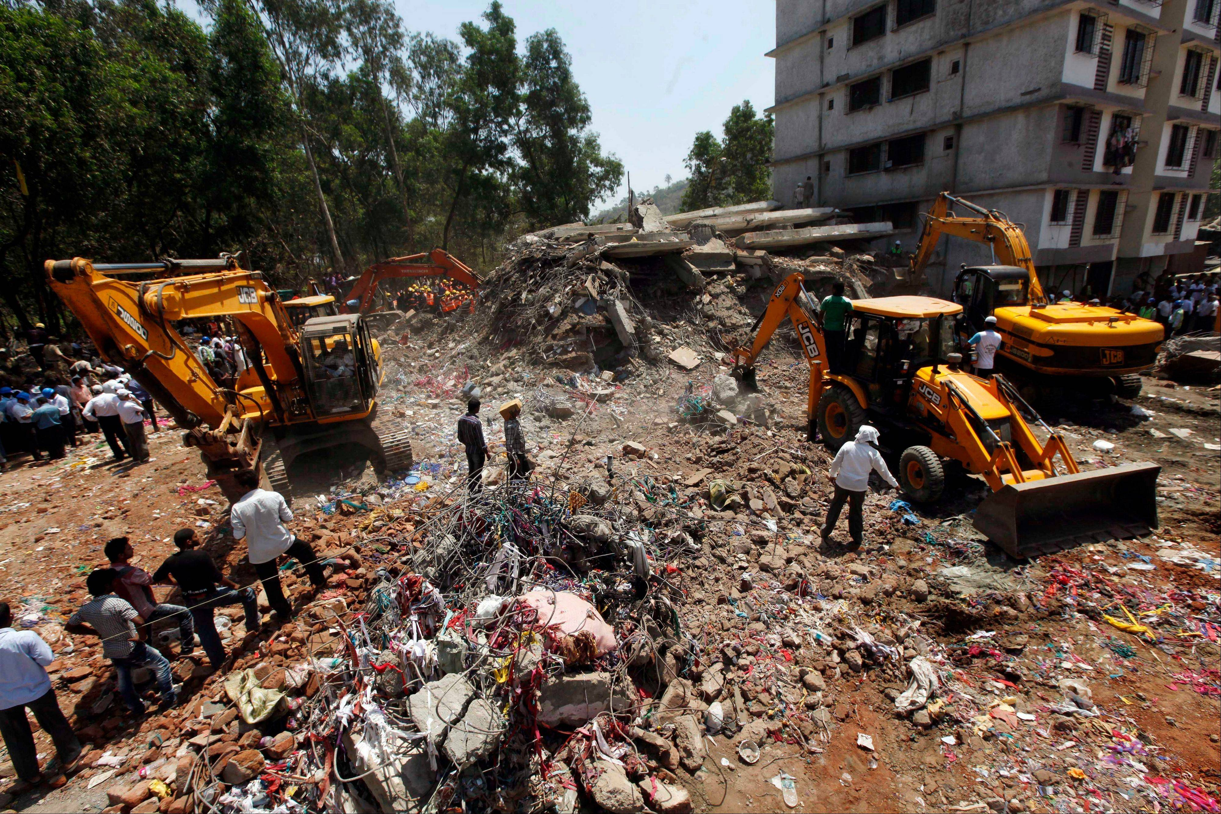 Rescue operation continues at the site of a building collapse on the outskirts of Mumbai, India, Friday, April 5, 2013. The half-finished building that was being constructed illegally in a suburb of India�s financial capital collapsed Thursday, killing 35 people and injuring more than 50 others, police said Friday.