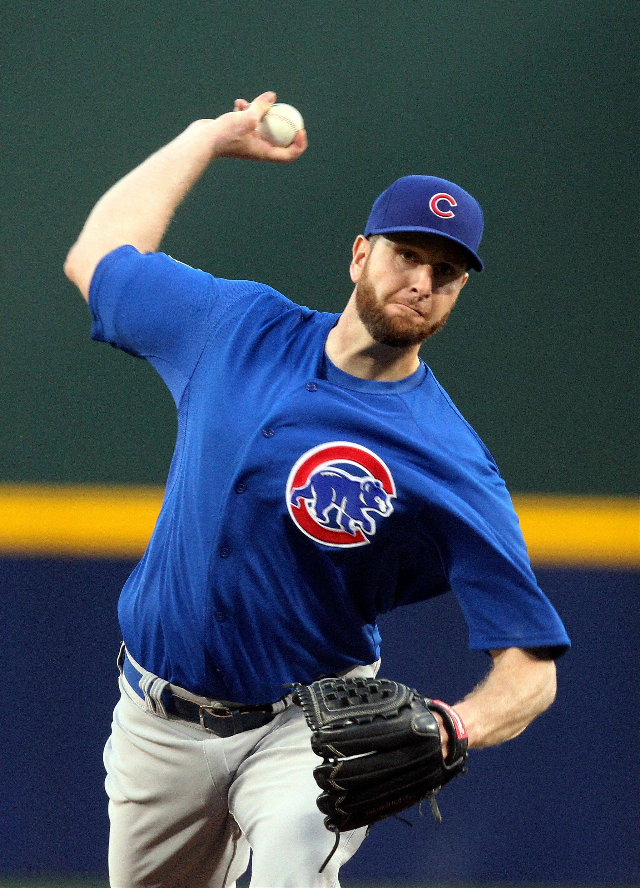 Chicago Cubs starting pitcher Scott Feldman pitches against the Atlanta Braves in the first inning of a baseball game, Friday, April 5, 2013, in Atlanta. (AP Photo/Butch Dill)