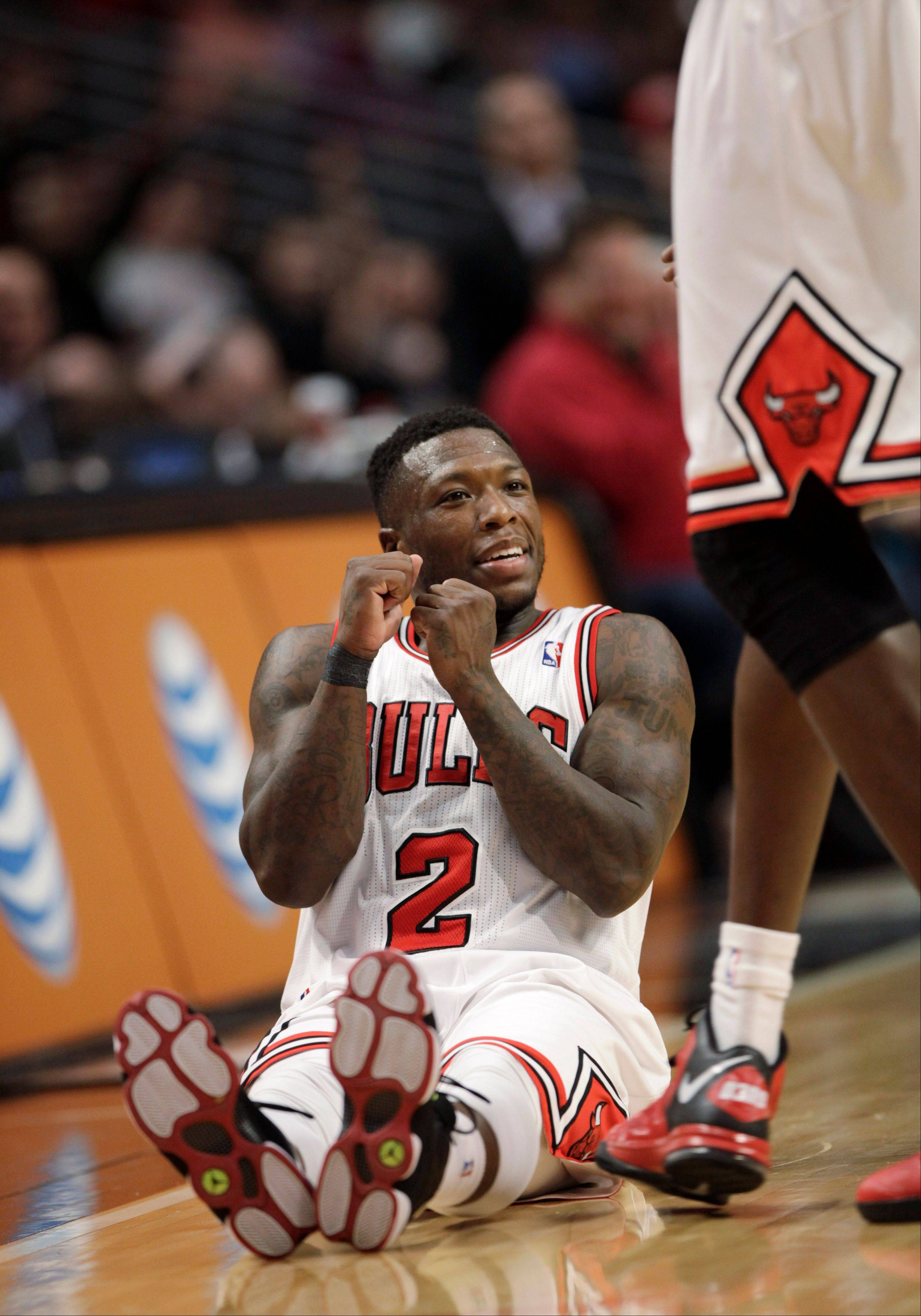 Nate Robinson does a dance while sitting on the floor after making a 3-point basket late in the fourth quarter as the Bulls defeated the Orlando Magic 87-86 in an NBA basketball game Friday, April 5, 2013, in Chicago.