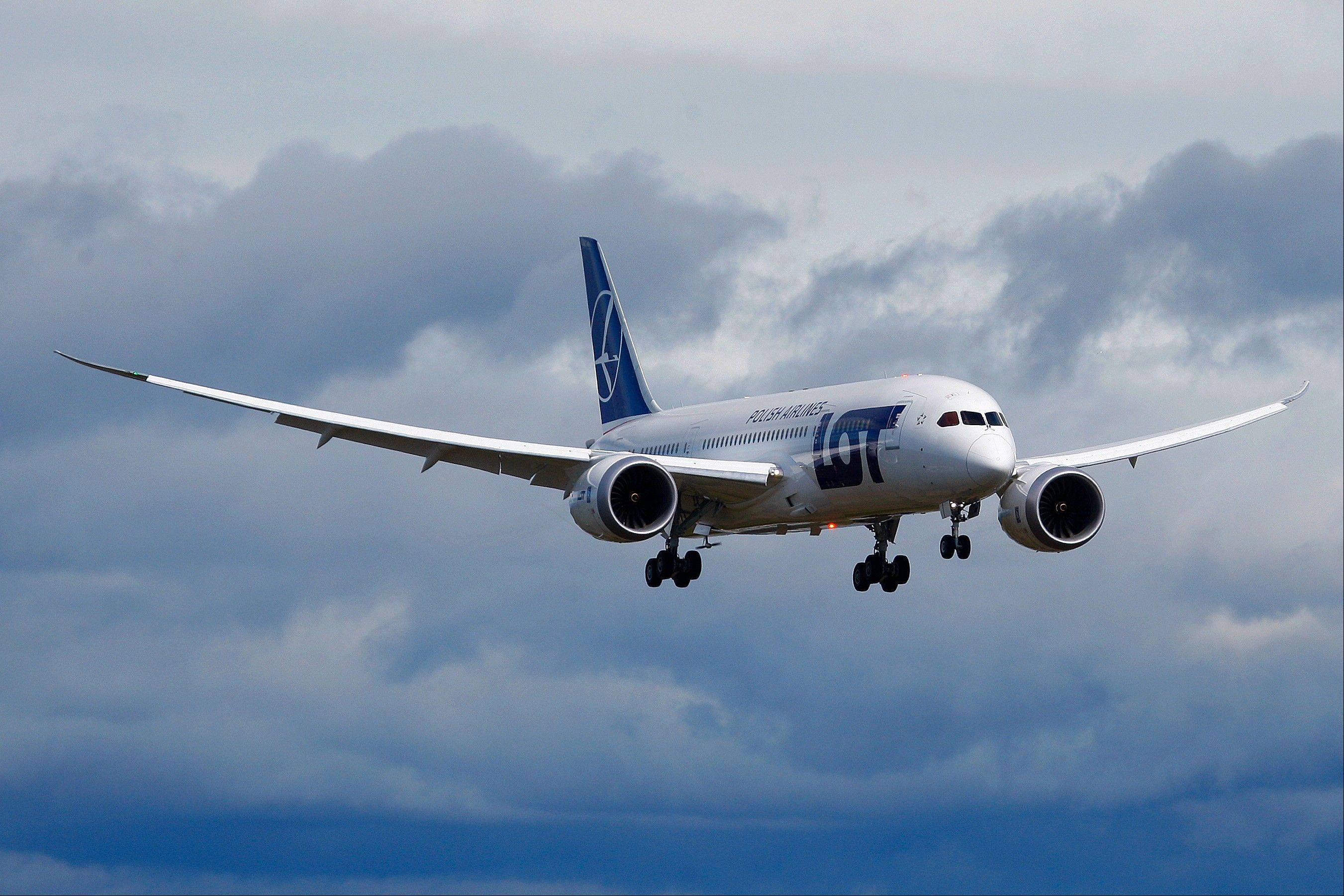 A Boeing-owned 787 production plane built for LOT Polish Airlines lands after a demonstration flight Friday meant to be the final certification test for the 787's new battery system at Paine Field in Everett, Wash.