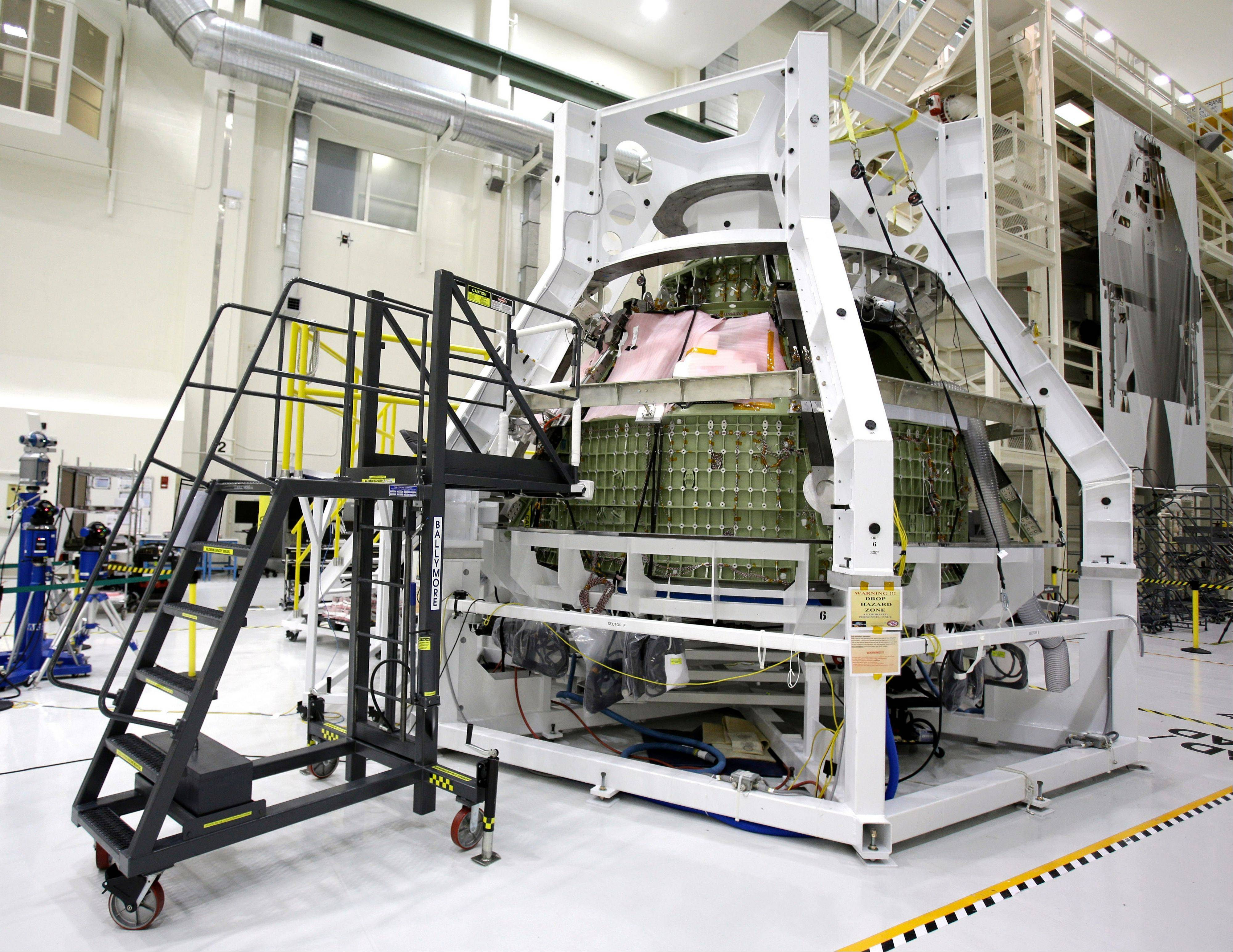 Associated Press/Jan. 13, 2013The Orion Exploration Flight Test 1crew module sits in the Operations and Checkout building during a media tour at the Kennedy Space Center in Cape Canaveral, Fla.