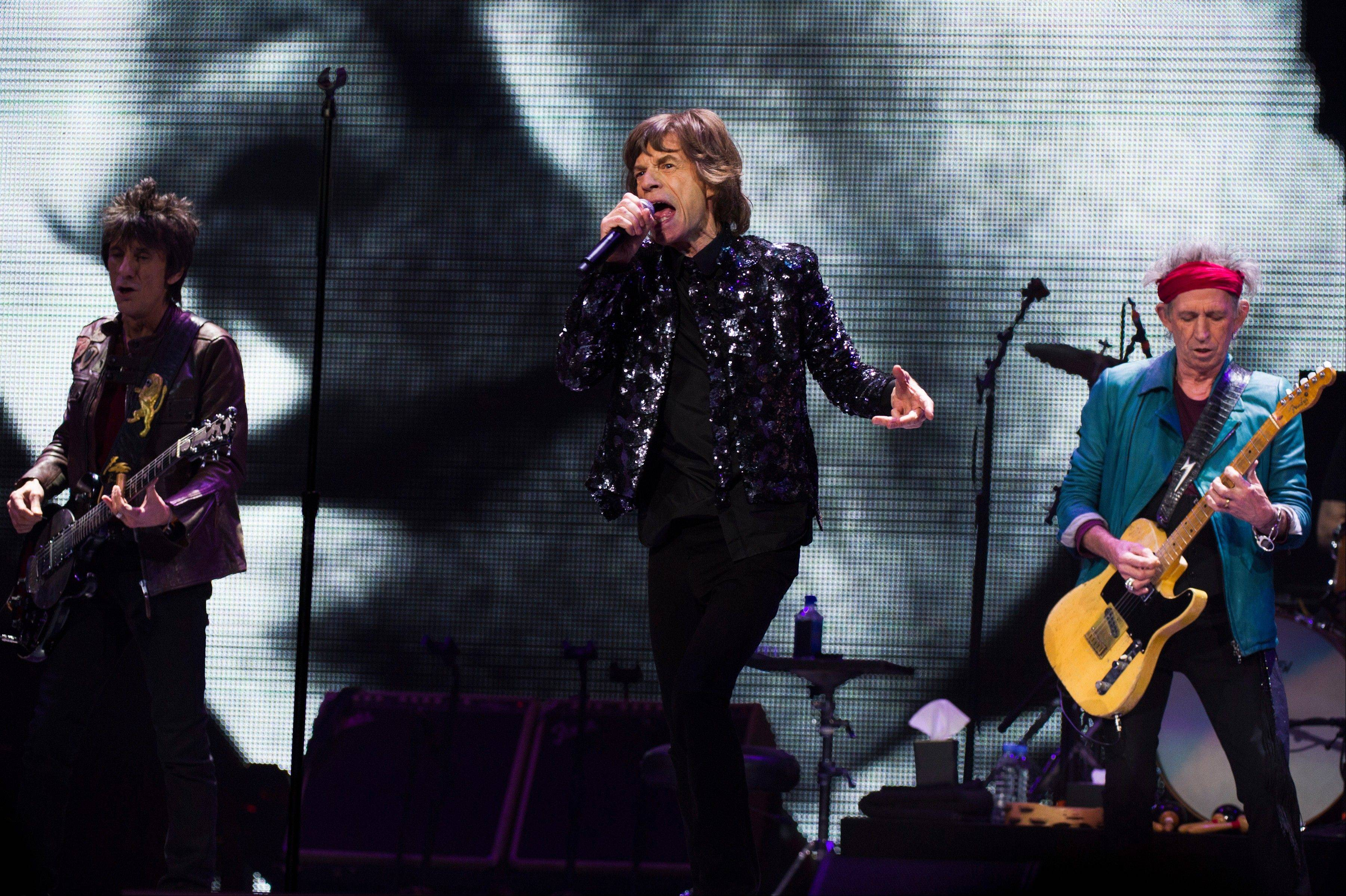 "Ronnie Wood, left, Mick Jagger and Keith Richards of The Rolling Stones will be playing another Chicago show on their ""50 and Counting"" tour."