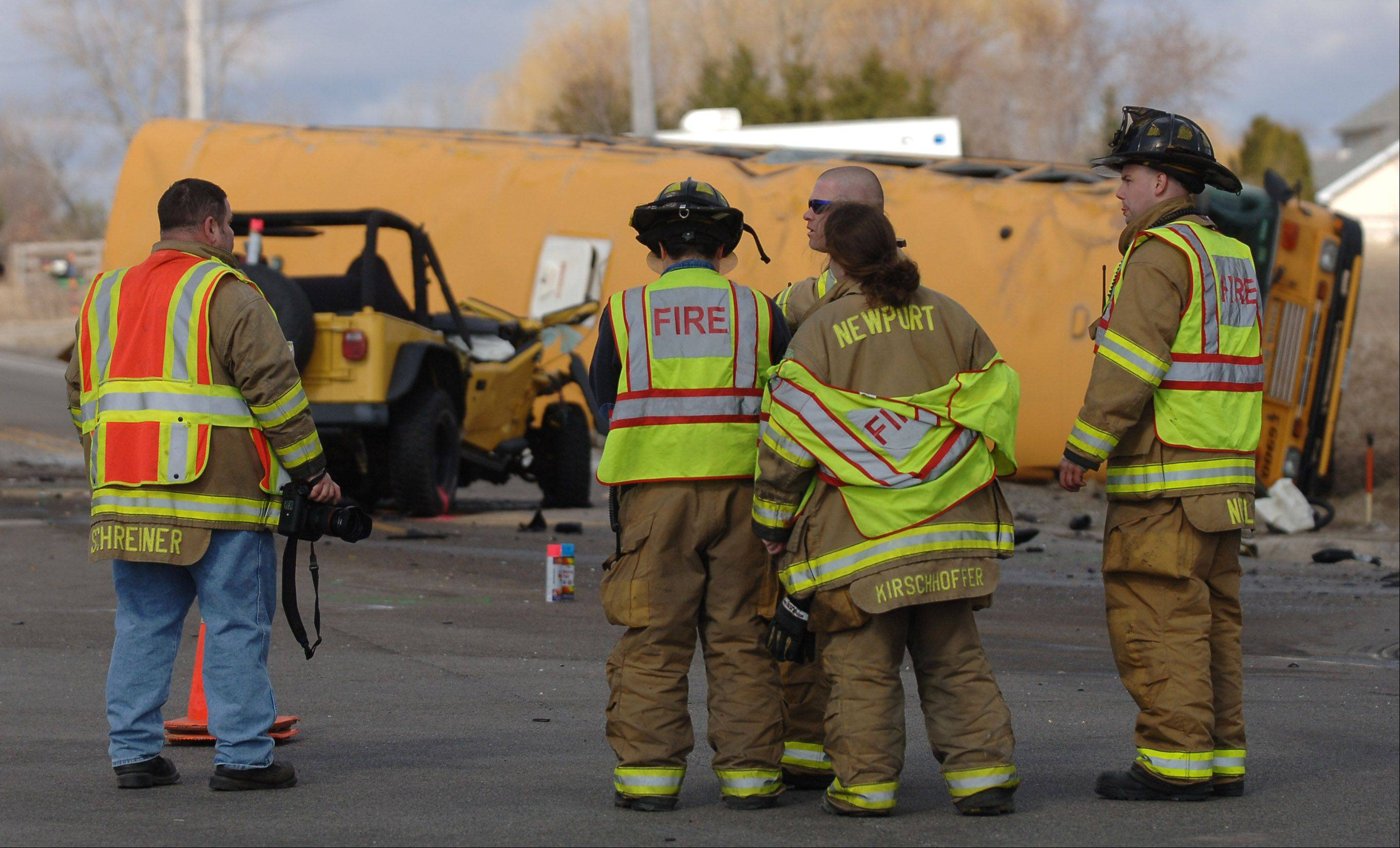 Firefighters at the scene of Friday morning's fatal crash at Route 173 and N. Kilbourne Road near Wadsworth.