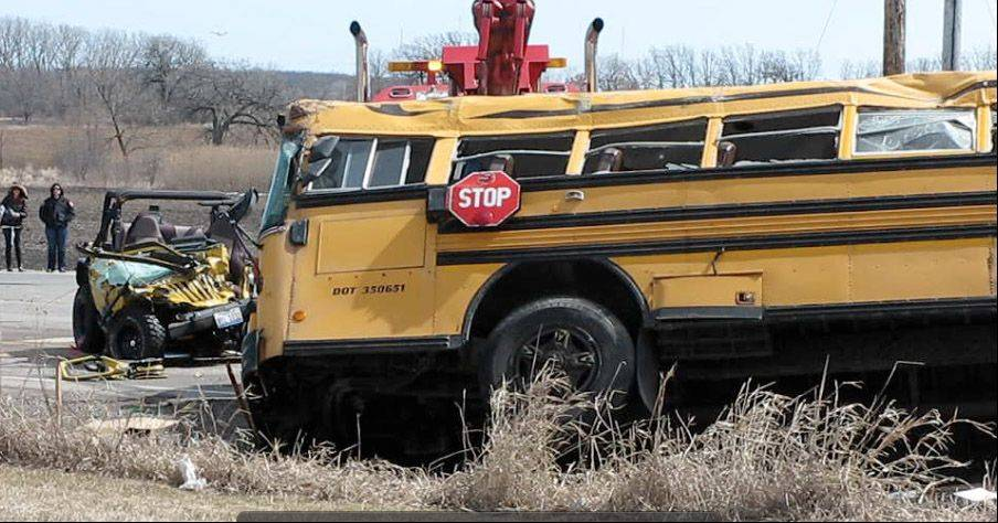 The school bus is set back on its wheels Friday afternoon following the morning's fatal accident at Route 173 and N. Kilbourne Road near Wadsworth. The drive of the Jeep Wrangler, left, was killed in the crash.