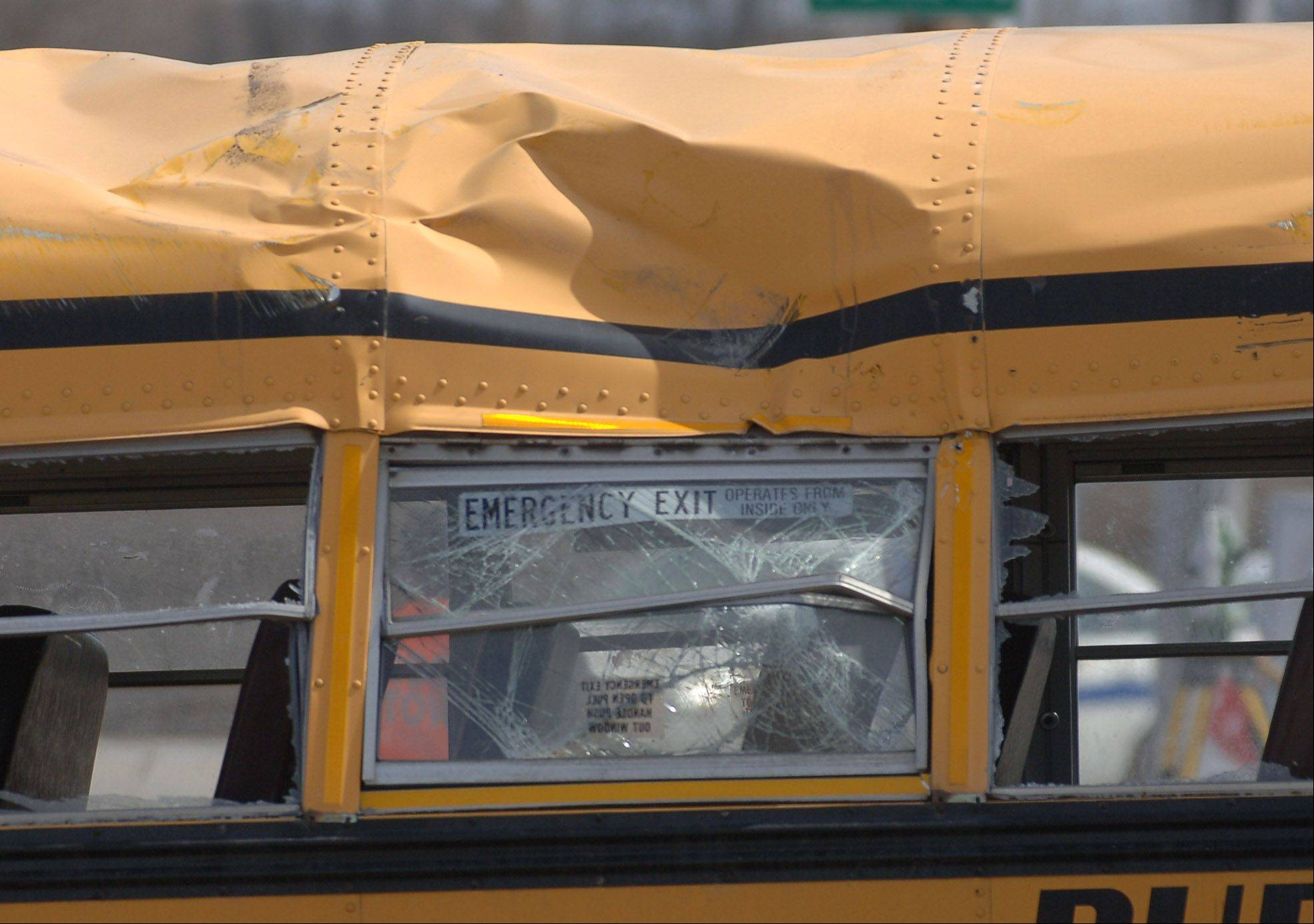 Paul Valade/pvalade@dailyherald.comSmashed windows can be seen on the school bus involved in Friday morning's accident near Wadsworth.