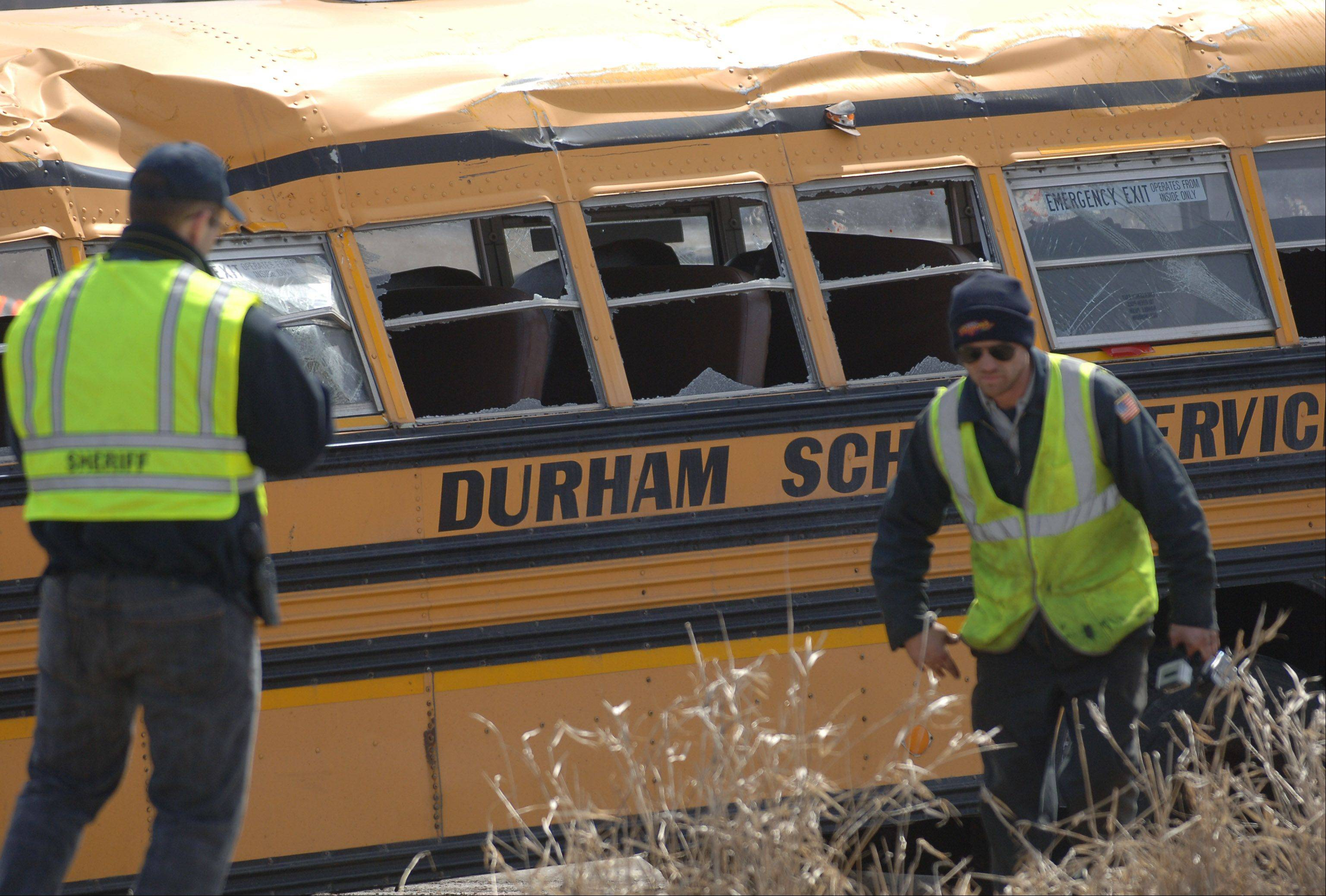 The damage to the school bus can be seen shortly after is was set back onto its wheels Friday afternoon.
