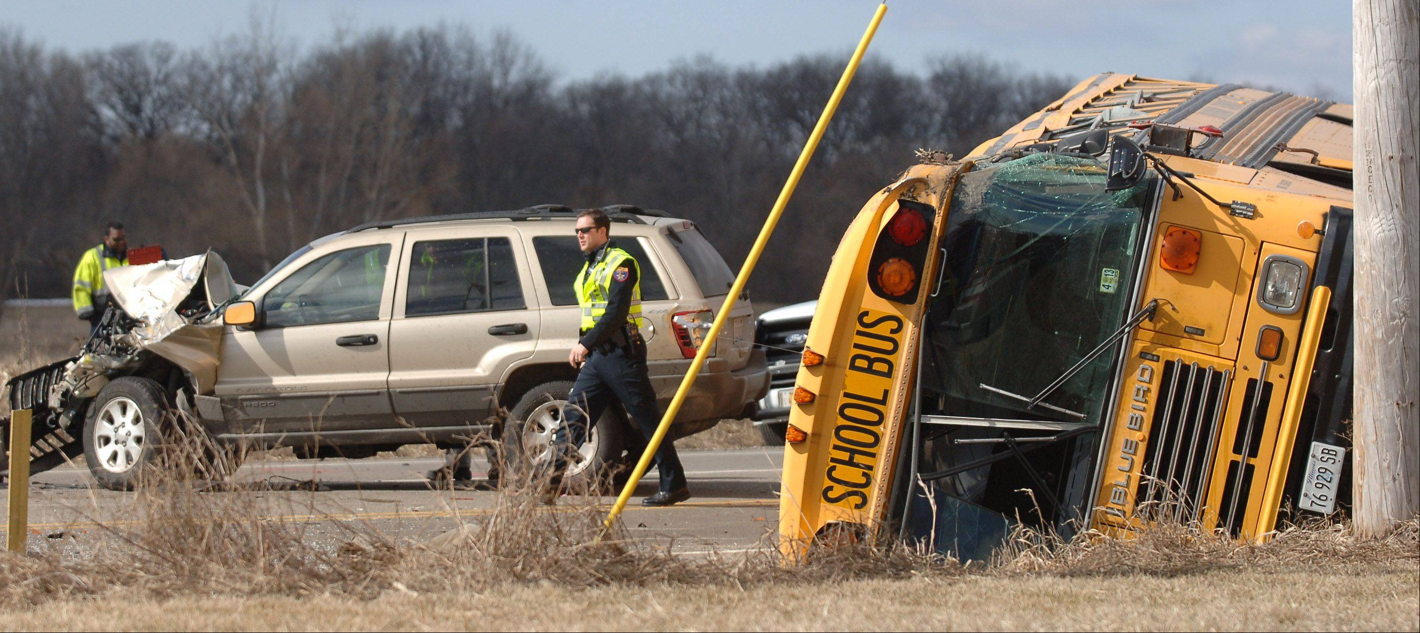A school bus came to rest on its side following a crash Friday morning at Route 173 and N. Kilbourne Road near Wadsworth.