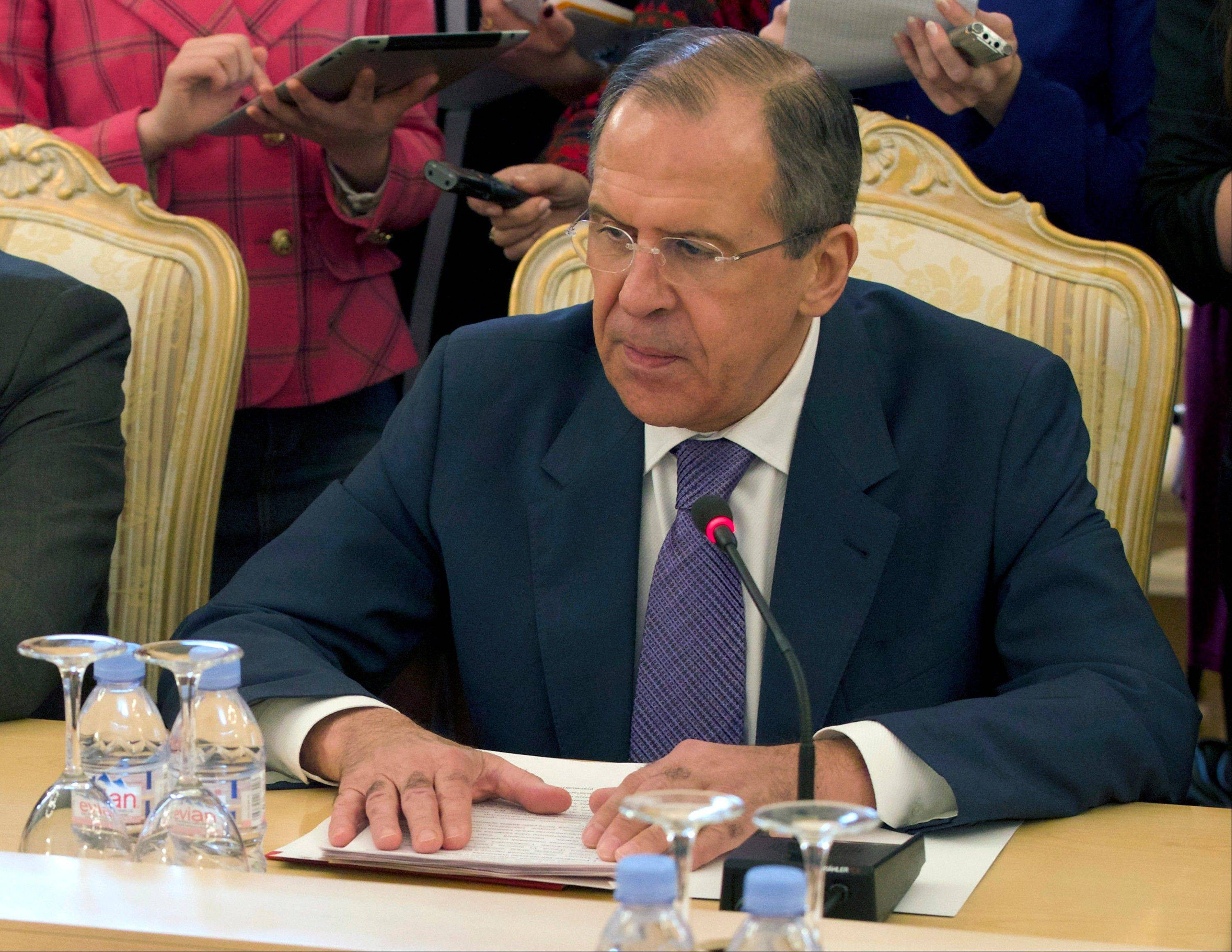 Russian Foreign Minister Sergey Lavrov lays his hands on the table during talks with Thailand's Foreign Minister, not pictured, in Moscow, Russia. Lavrov is demanding an explanation for the North Korean warning that it can't guarantee the safety of embassies in its capital of Pyongyang.