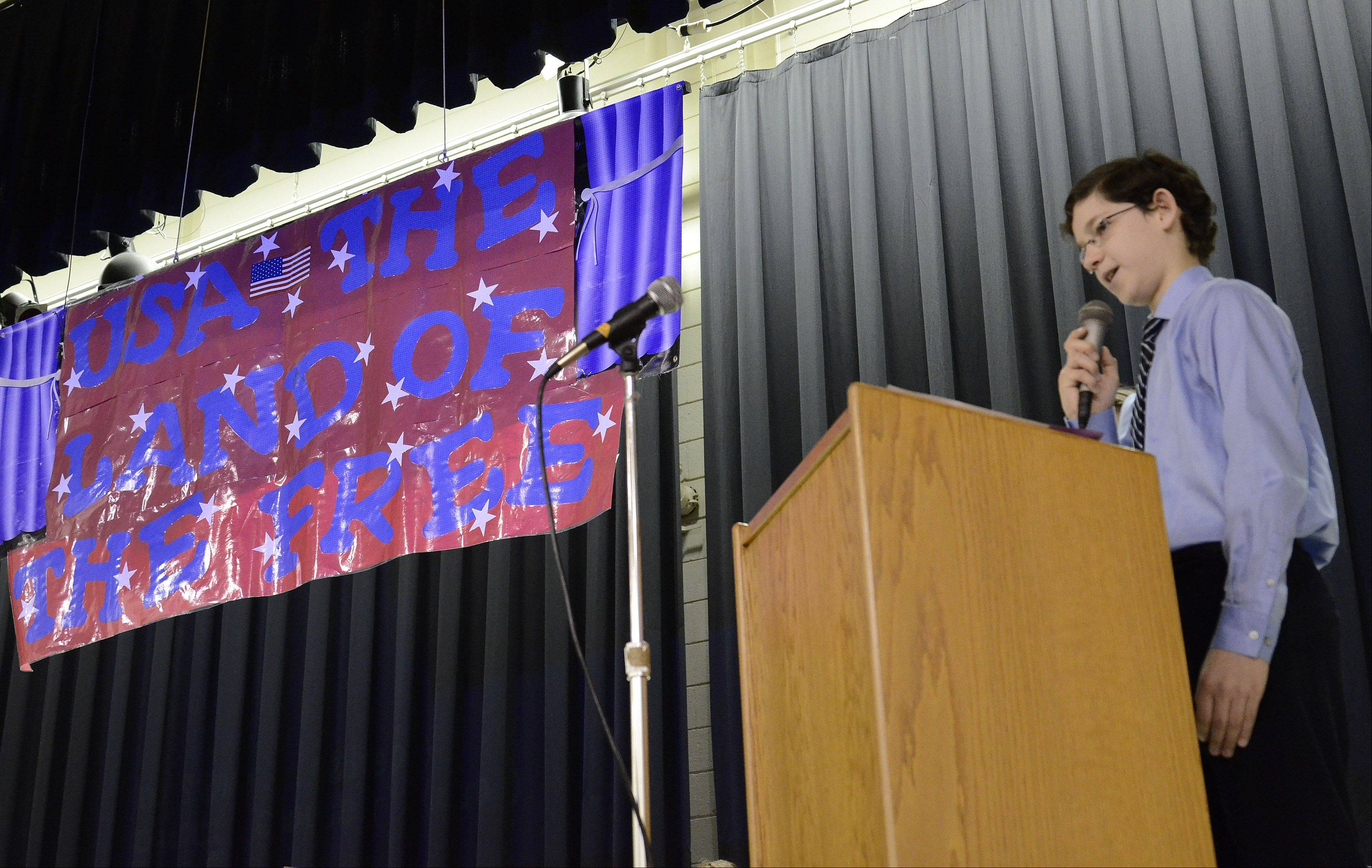 "Seventh-grader Jonny Leeb gives his presentation Thursday as District 21 students present ""Fair Pathways to Citizenship,"" a culmination of their monthlong study of U.S. immigration."