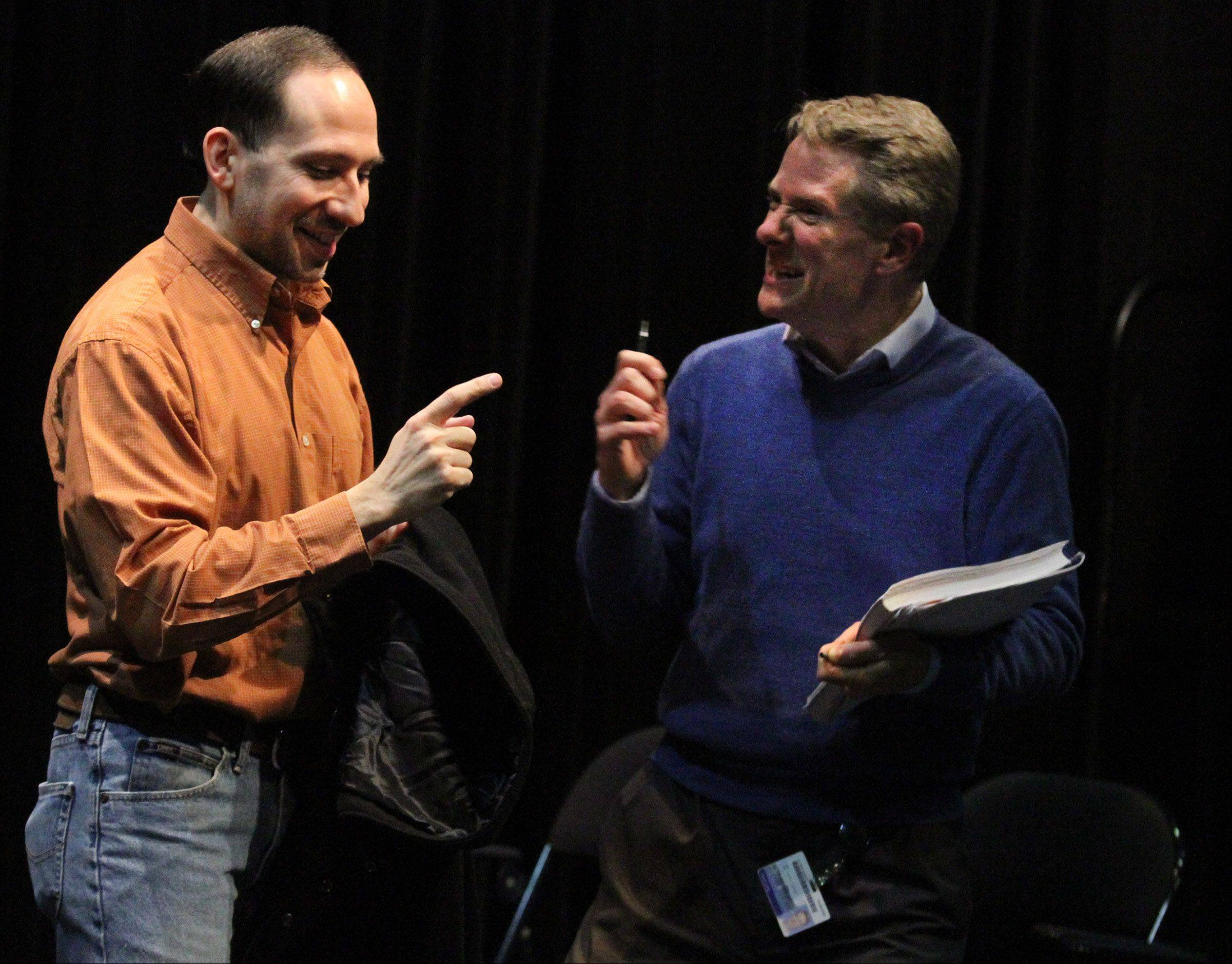 "Kevin Long, right, directs David Pfenninger of Lombard playing the part of Leo Frank during rehearsal of the musical ""Parade"" in the Black Box Theatre."
