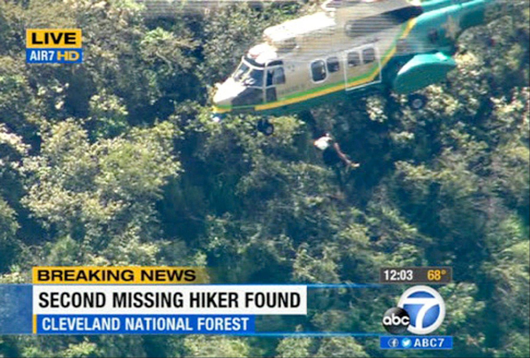 This video image provided by KABC-TV shows the air rescue of Kyndall Jack, 18, who was hoisted out of Cleveland National Forest, California, after being missing for four days, Thursday April 4, 2013. Her hiking companion, Nicolas Cendoya, 19, was discovered without shoes by another hiker Wednesday less than a mile from where the pair's car was parked.