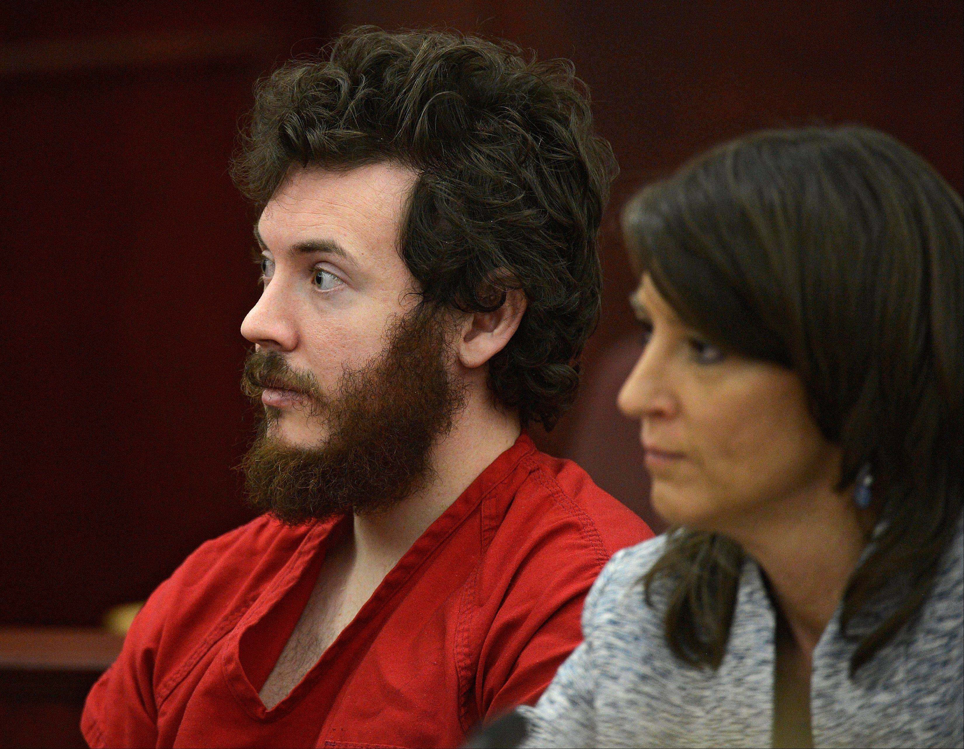 James Holmes, left, and defense attorney Tamara Brady appear in district court in Centennial, Colo. for his arraignment. Court documents are raising new questions for the university that Colorado theater shooting suspect James Holmes attended before the July 20 theater shooting that left 12 people dead and 70 injured.