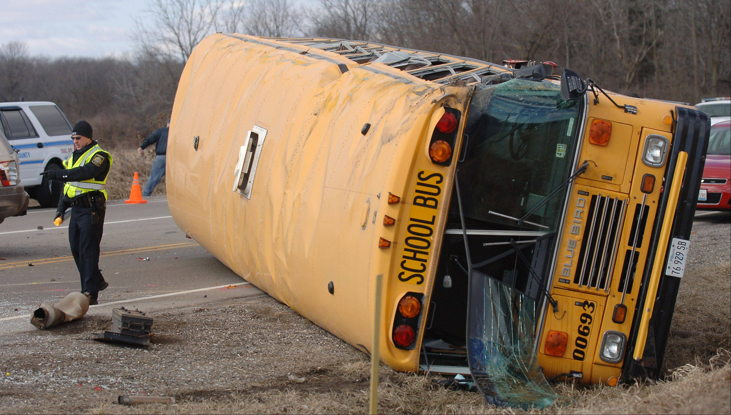 Officials investigate a fatal crash involving two vehicles and a school bus Friday morning at Route 173 and N. Kilbourne Road near Wadsworth. A driver in one of the vehicles was killed, while children on the school bus and occupants of the second vehicle in the crash were injured.