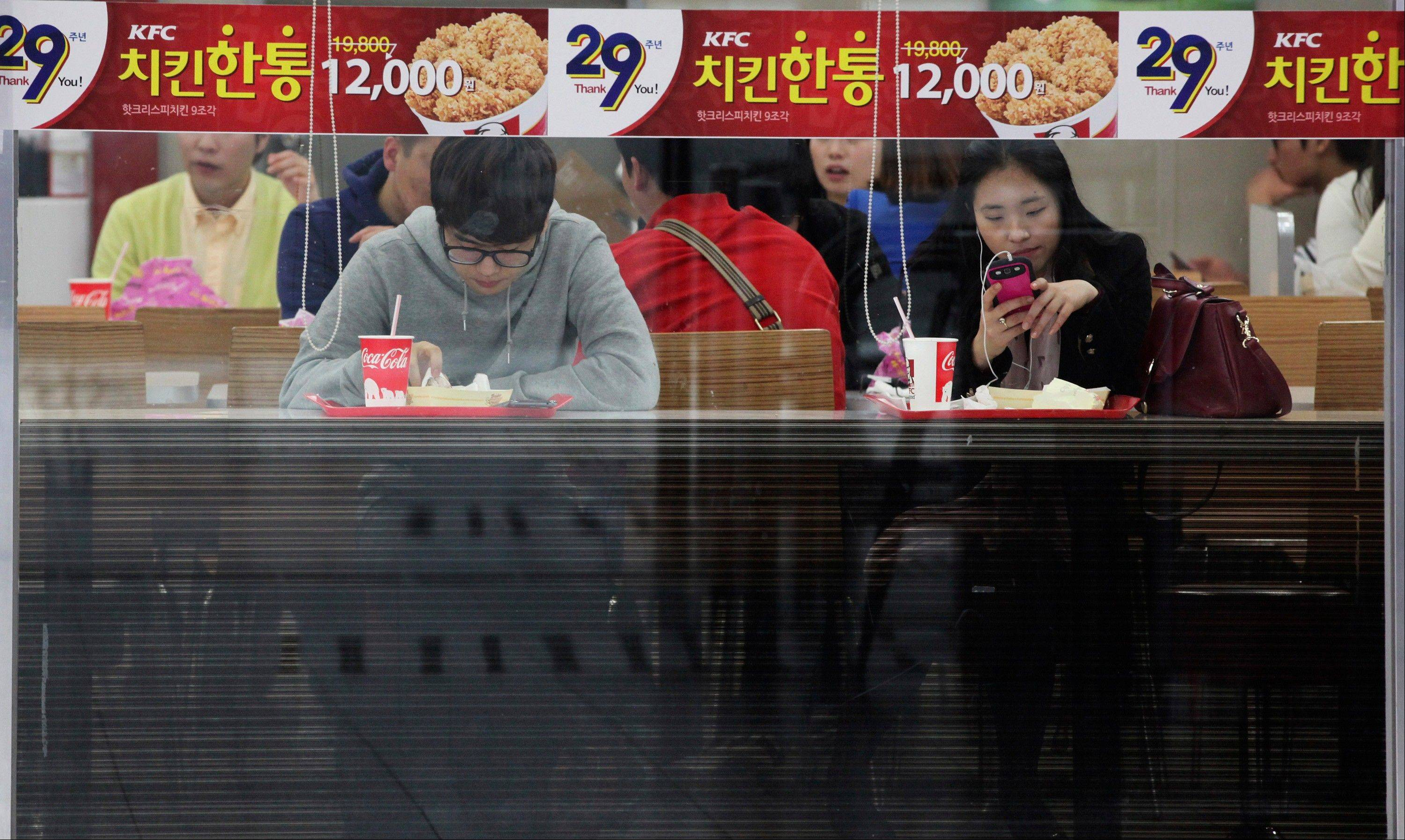 Outsiders might hear the opening notes of a war in the deluge of threats and provocations from North Korea, but to South Koreans it is a familiar song. Foreigners unused to North Korean rumblings have canceled trips to the Korean Peninsula. But to get South Koreans' attention, Pyongyang must compete with the economy, celebrity scandals, baseball games and cherry blossoms.
