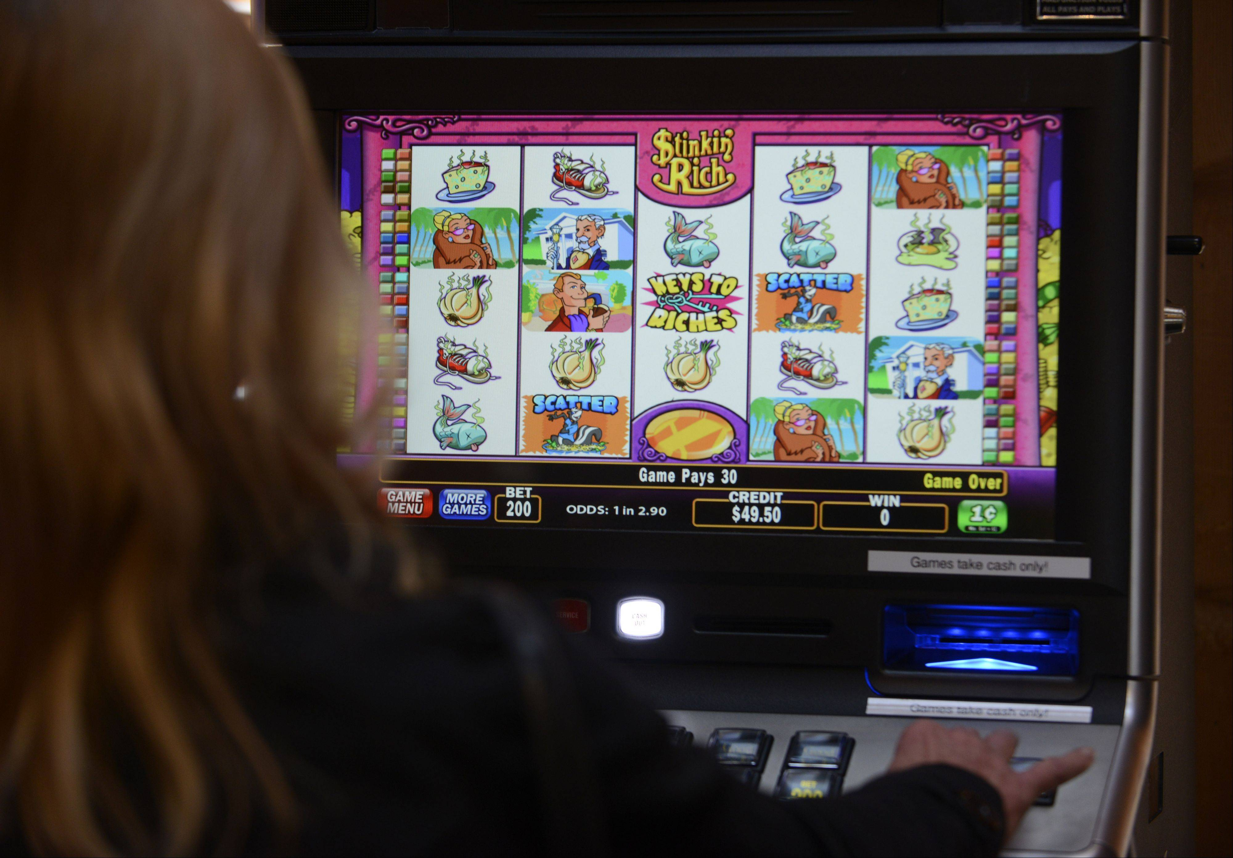A customer plays a video gambling machine at The Assembly American Bar and Café in Hoffman Estates.