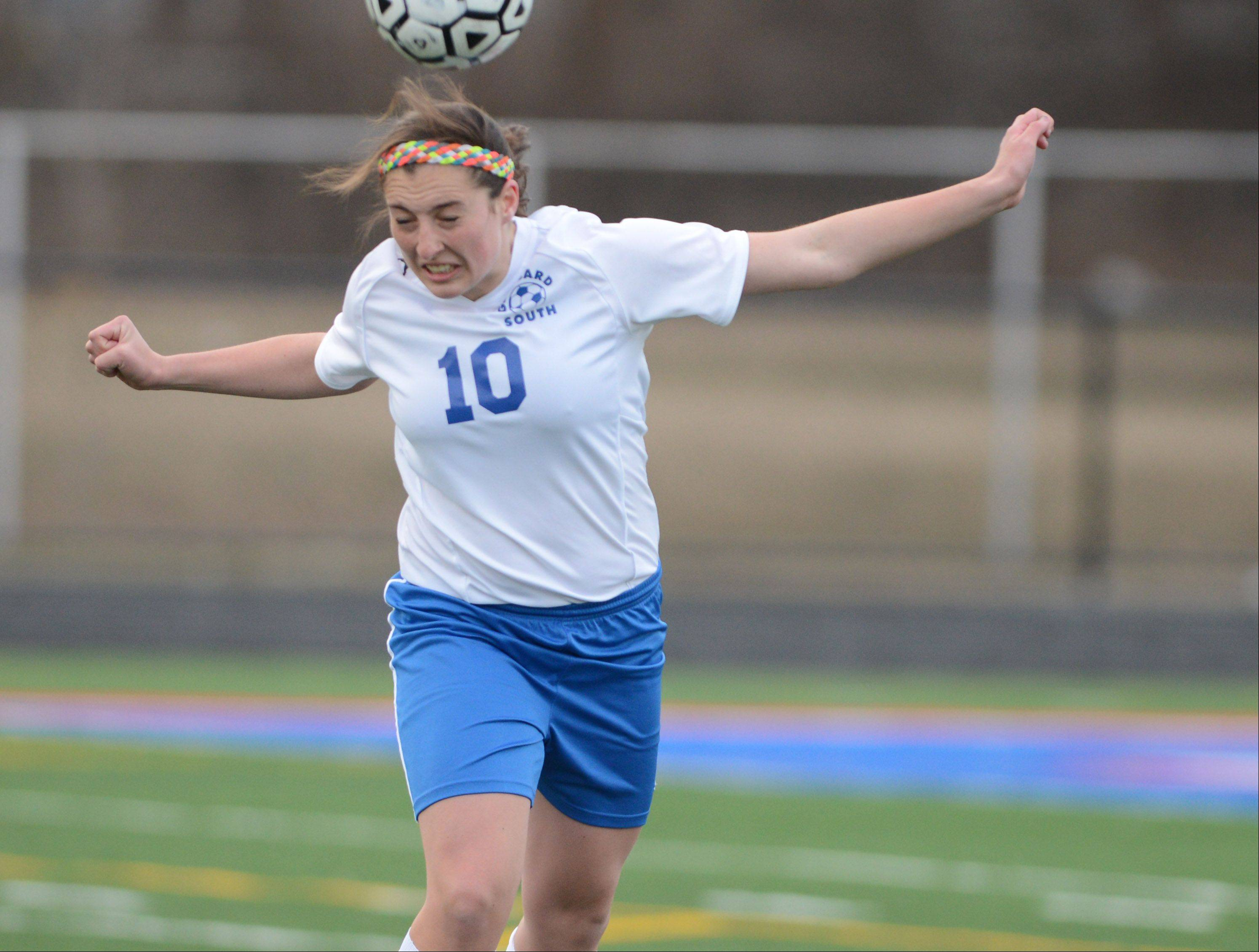 Stephanie Brennan of Glenbard South heads a ball during the St. Francis at Glenbard South girls soccer game Friday.