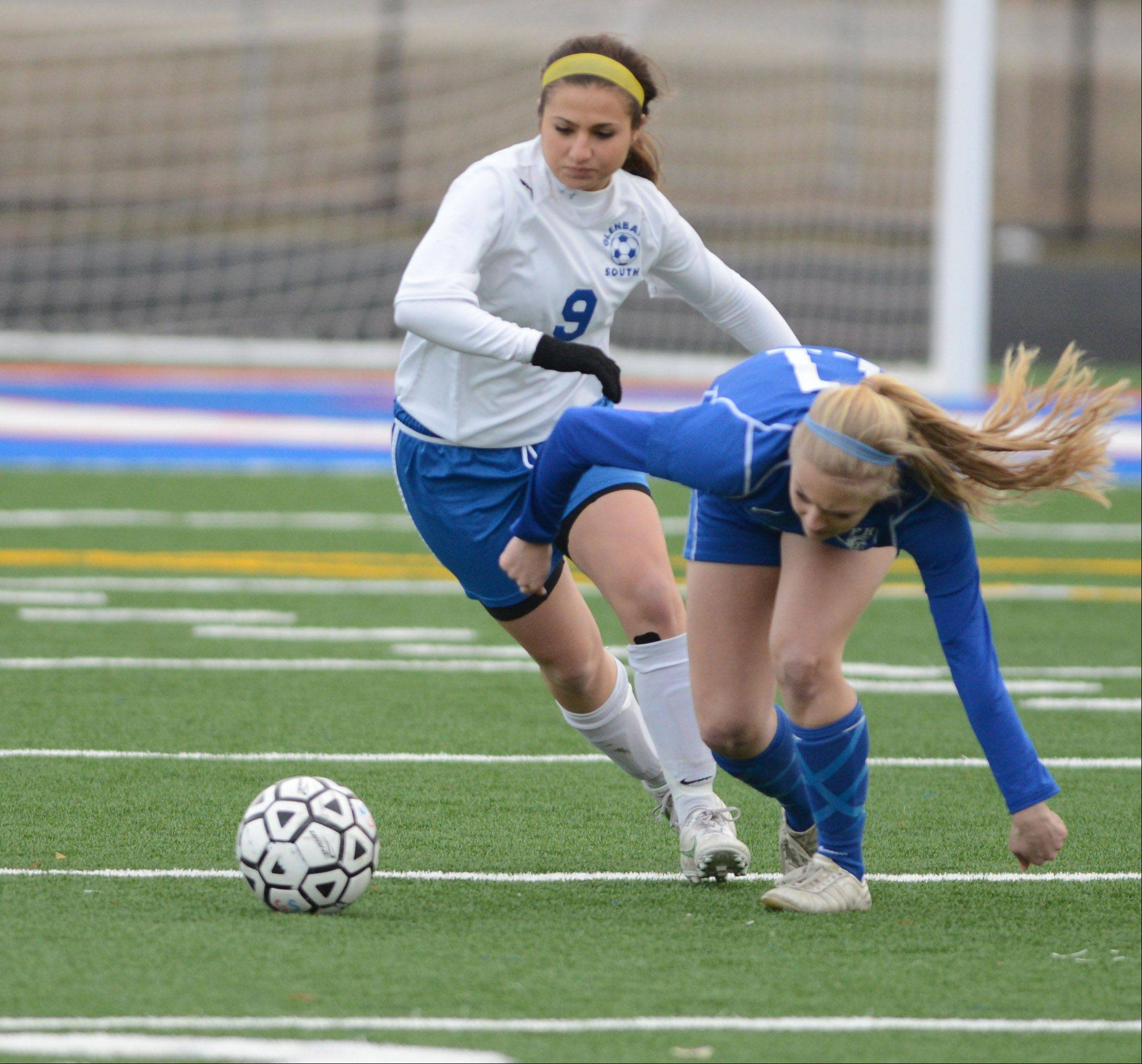 Danielle Pitaro,left, of Glenbard South and Corky Hart of St. Francis go after a loose ball during the St. Francis at Glenbard South girls soccer gamer Friday.