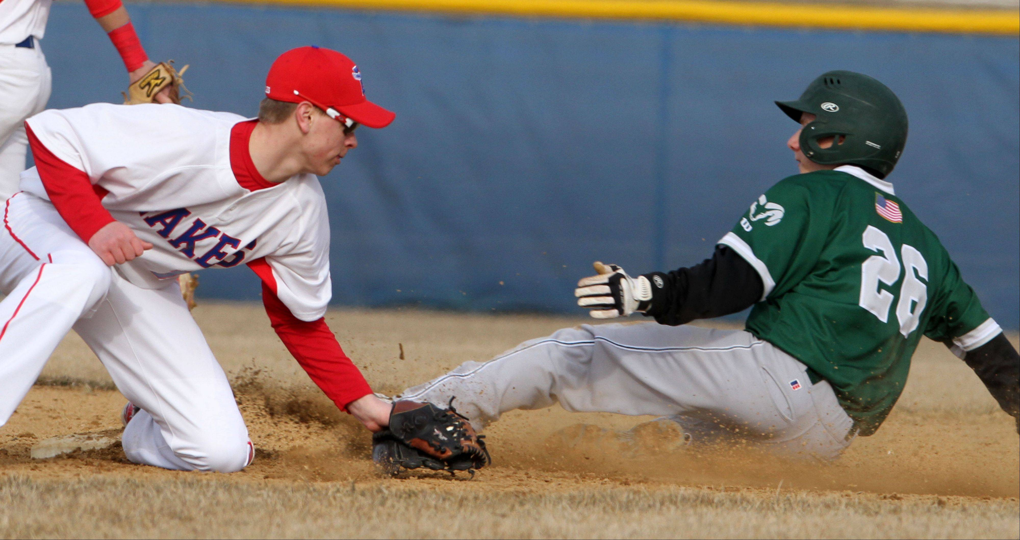 Grayslake Central Justin Allen is safe at second as Lakes' Nick Seketa applies the tag at Lakes on Friday.