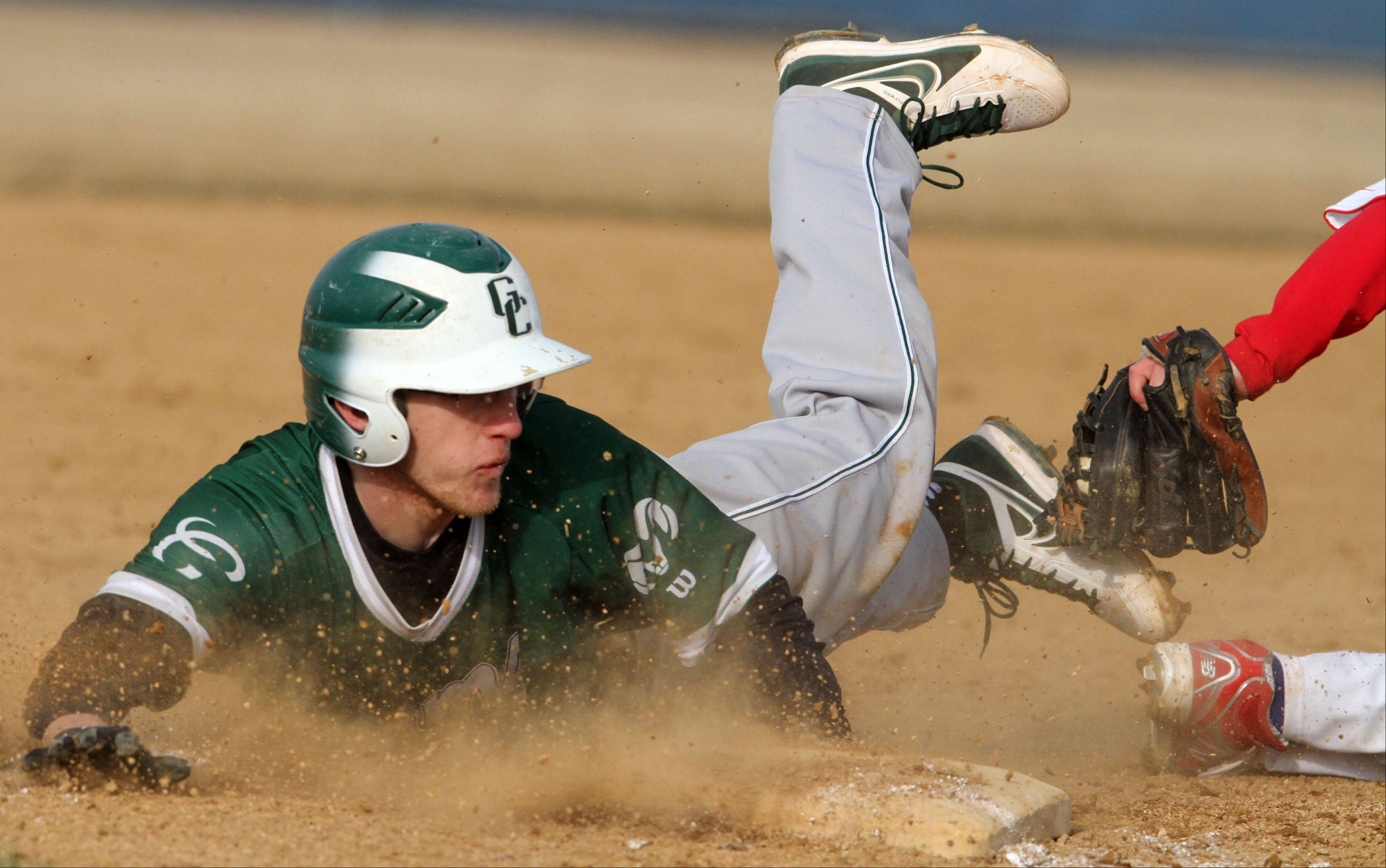 Grayslake Central's Danny Reed is called safe sliding head first into third-base as Lakes' Nick Seketa attempts to apply the tag at Lakes on Friday.