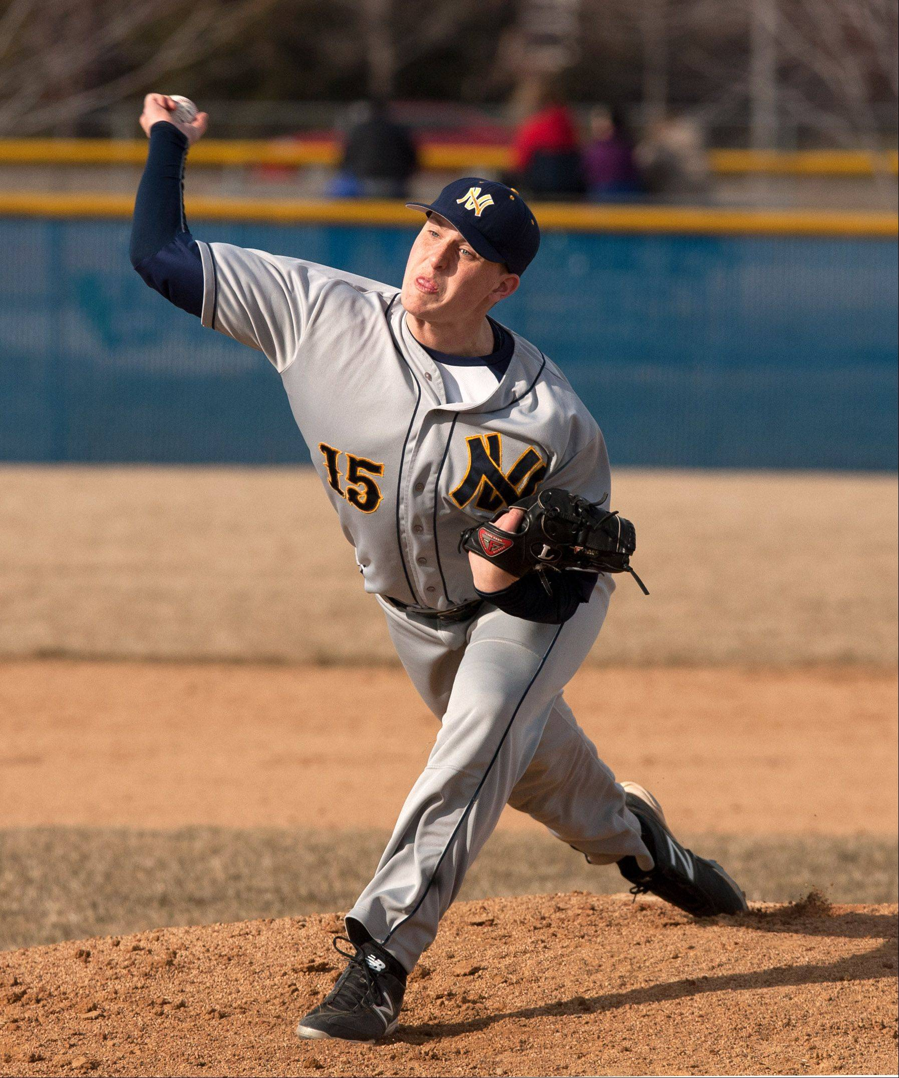 Neuqua Valley pitcher Cody Coll delivers a pitch during boys baseball action in Naperville.